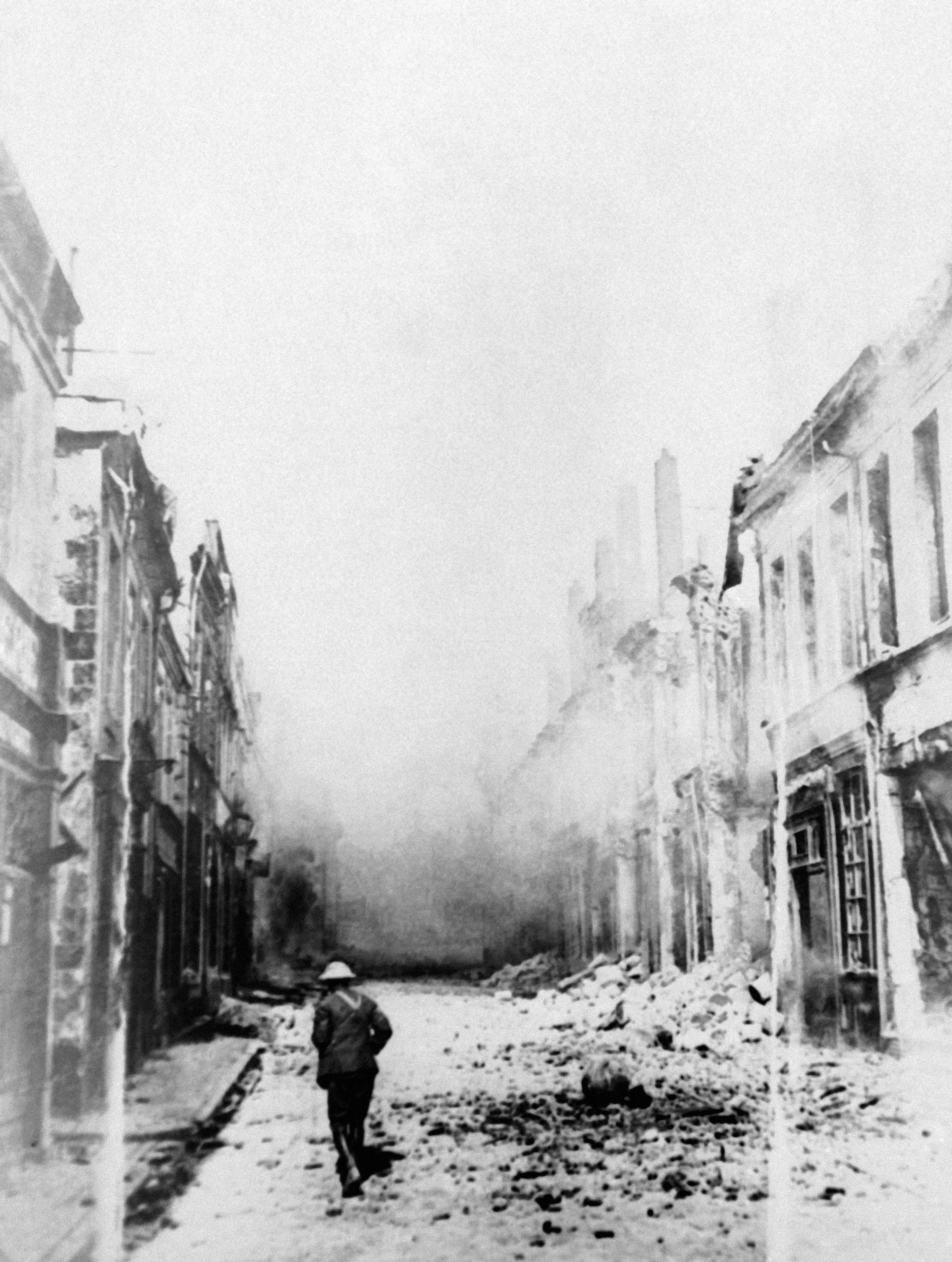 74 OF 100: In this December 1917 file photo, smoke billows out of buildings in Cambrai, France, after being bombarded by German forces during the World War I Battle of Cambrai.