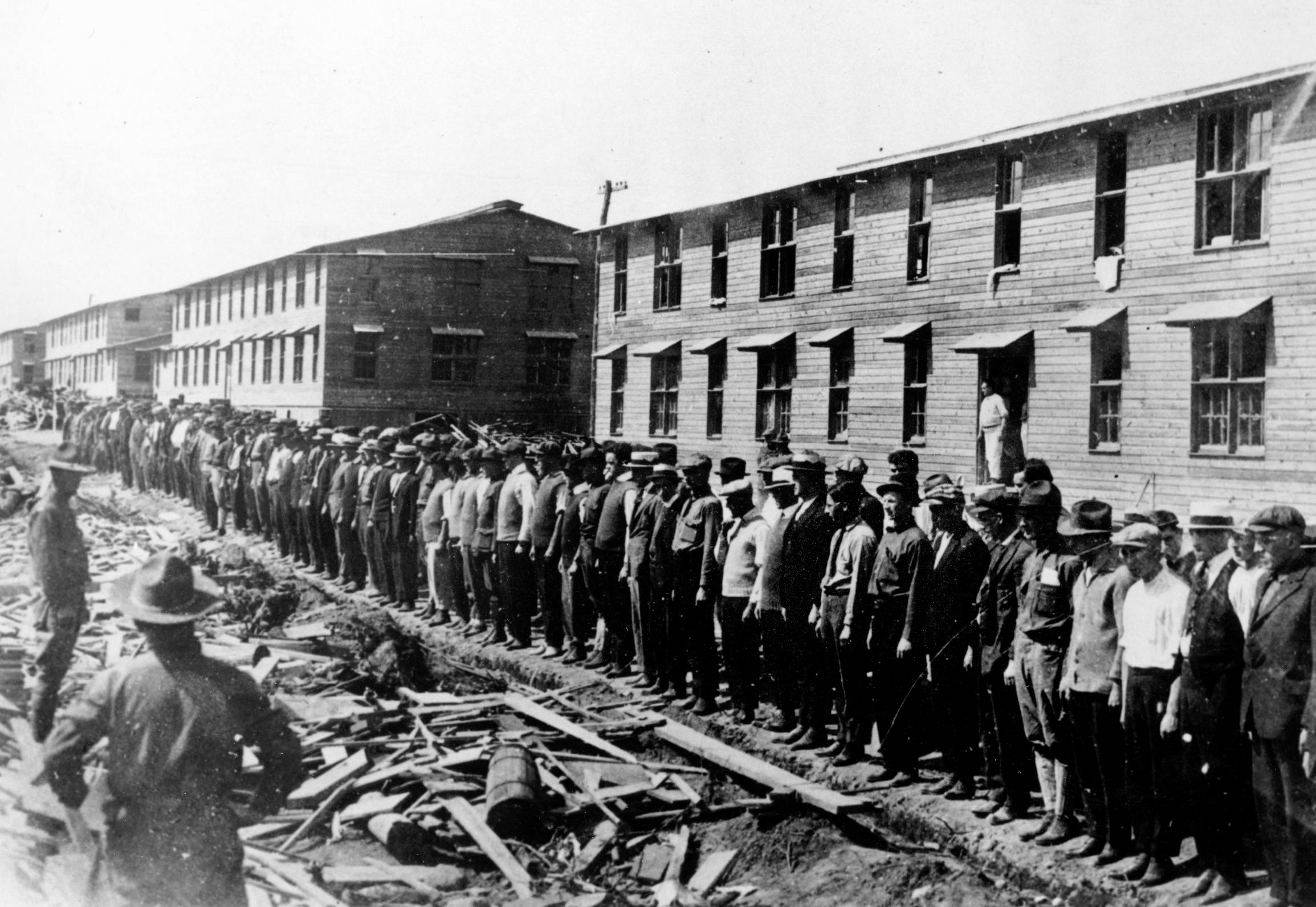 77 OF 100: In this 1917 file photo, members of the first contingent of New Yorkers drafted into the U.S. Army line up in front of their barracks at Camp Upton, Yaphank, Long Island, N.Y.