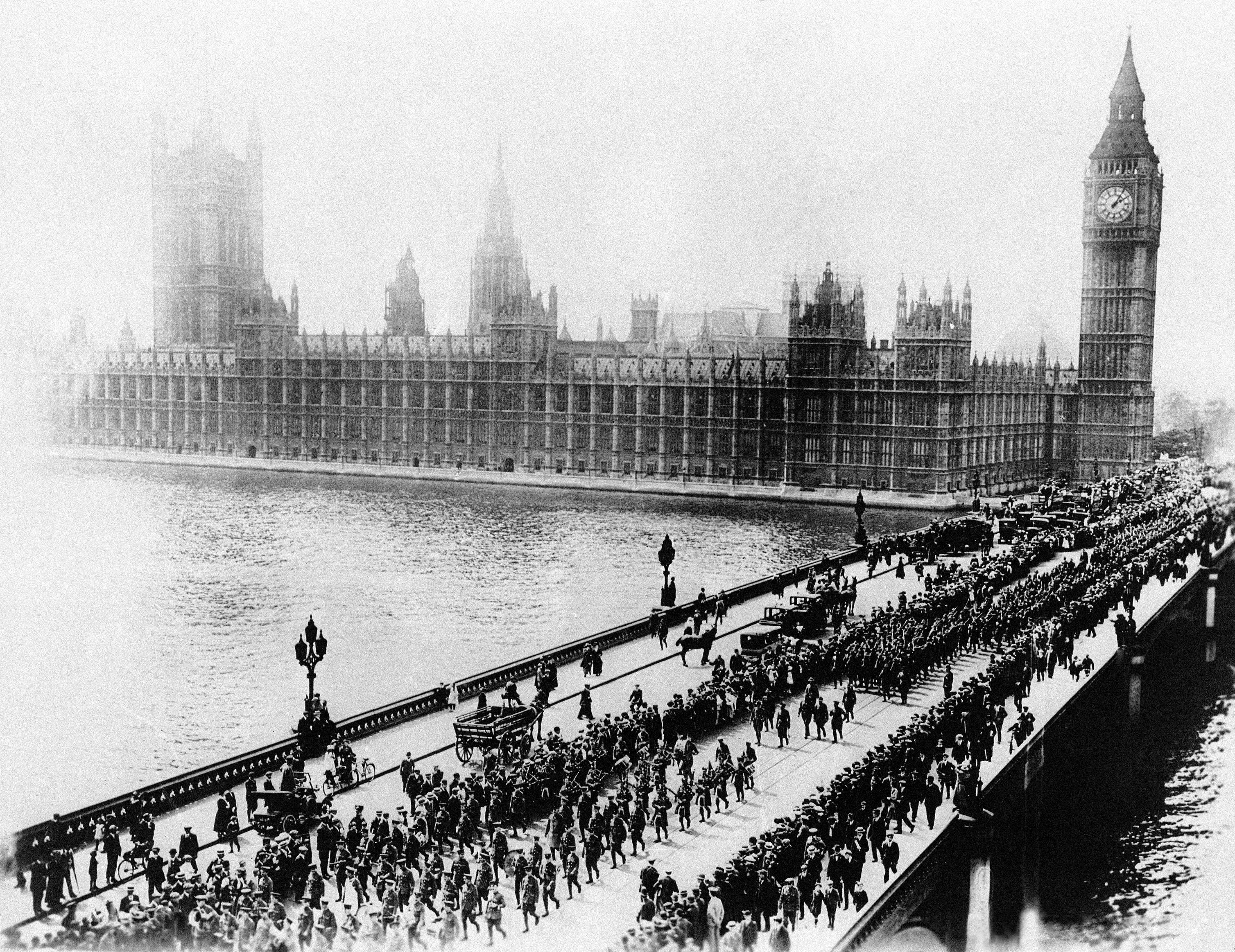 79 OF 100: In this 1917 photo provided by the U.S. Signal Corps, the first 5,000 American soldiers to reach England march across historic Westminster Bridge in London.