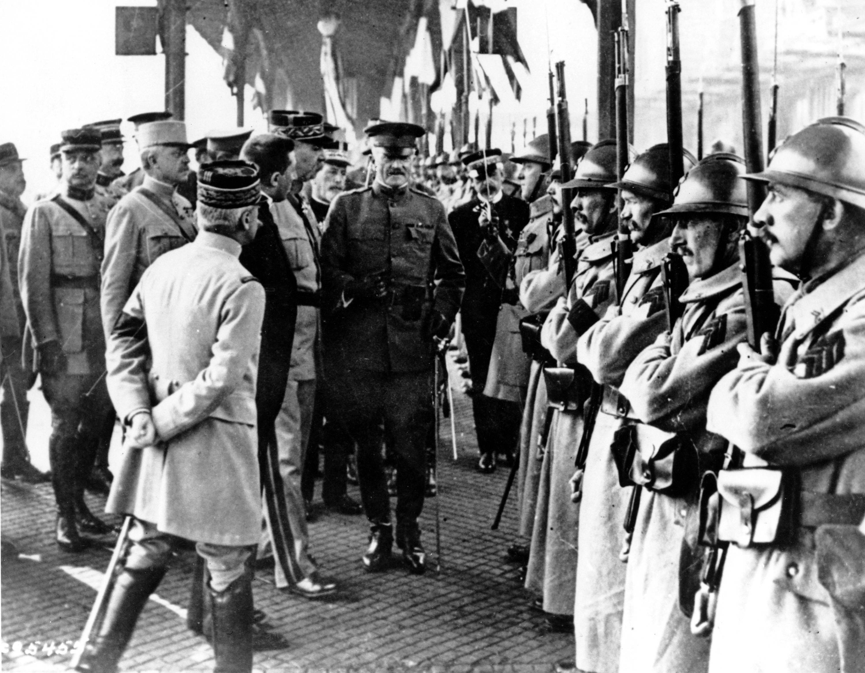 80 OF 100: In this June 13, 1917, file photo, U.S. Army Gen. John J. Pershing, center, inspects French troops at Boulogne, France.