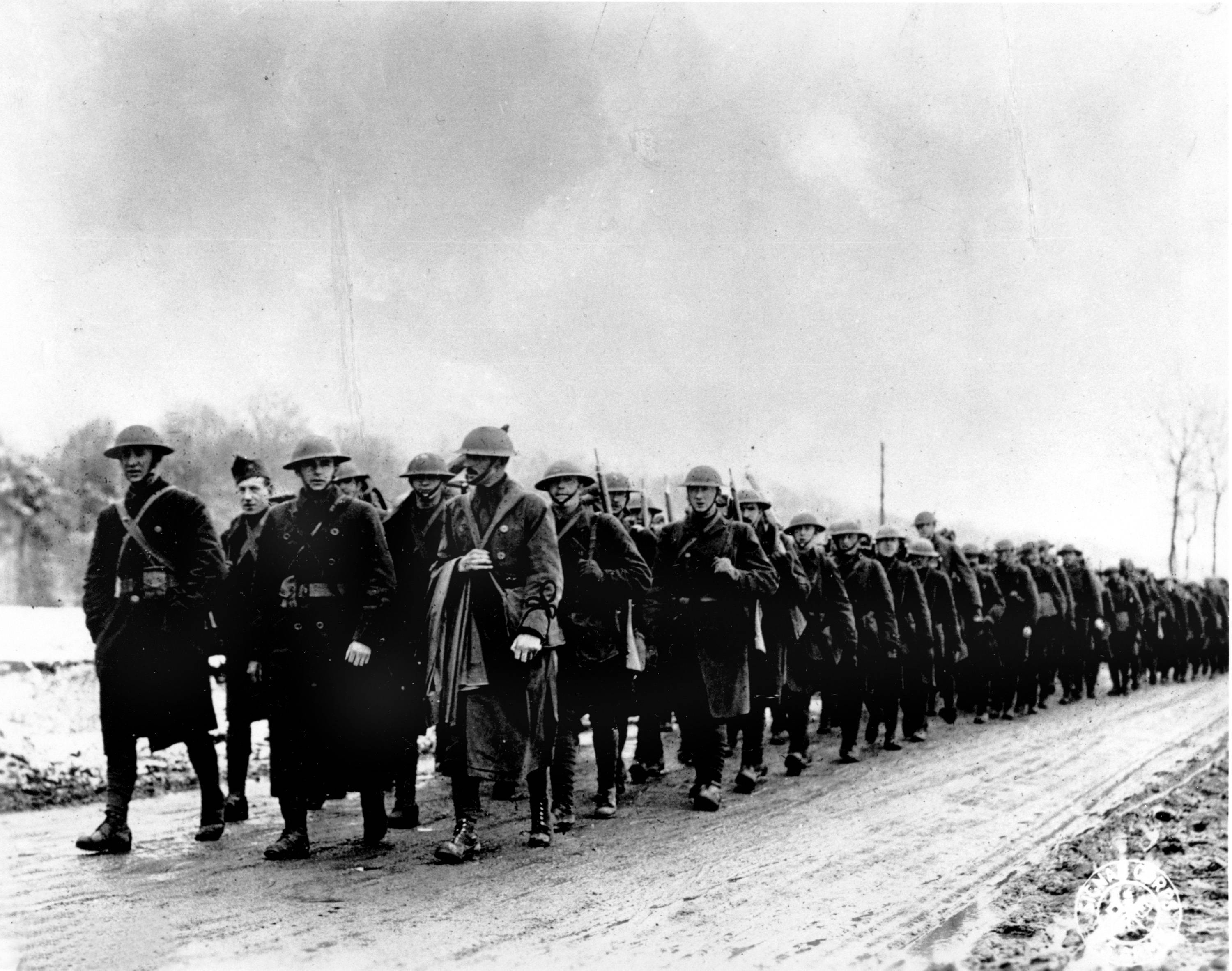 82 OF 100: In this March 1918 file photo, American soldiers of Company K, 165th Infantry of the Fighting 69th, Old Rainbow Division, march to the trenches at St. Clement, France during World War I.
