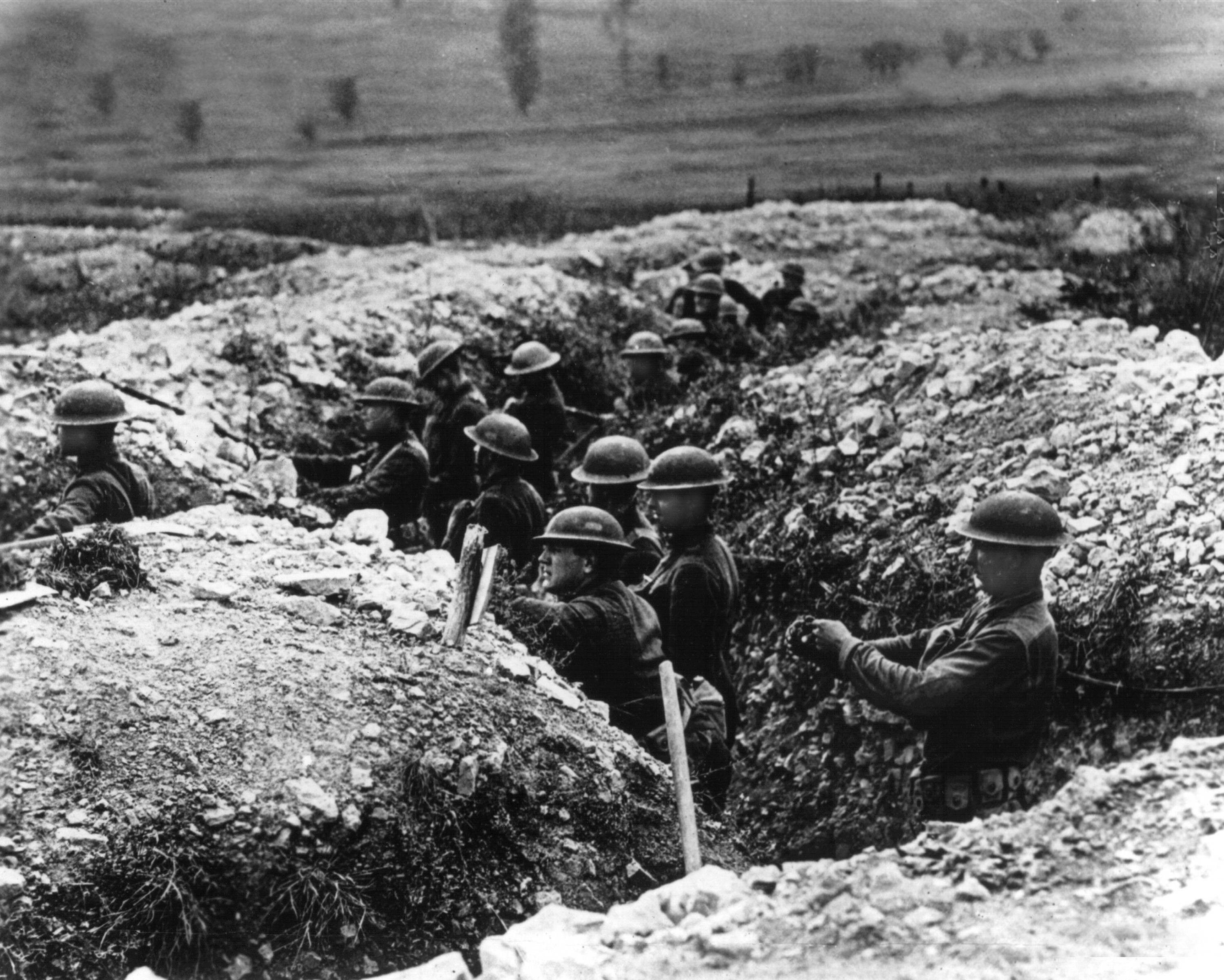 88 OF 100: In this undated file photo, U.S. Army troops stand in the trenches in France during World War I.