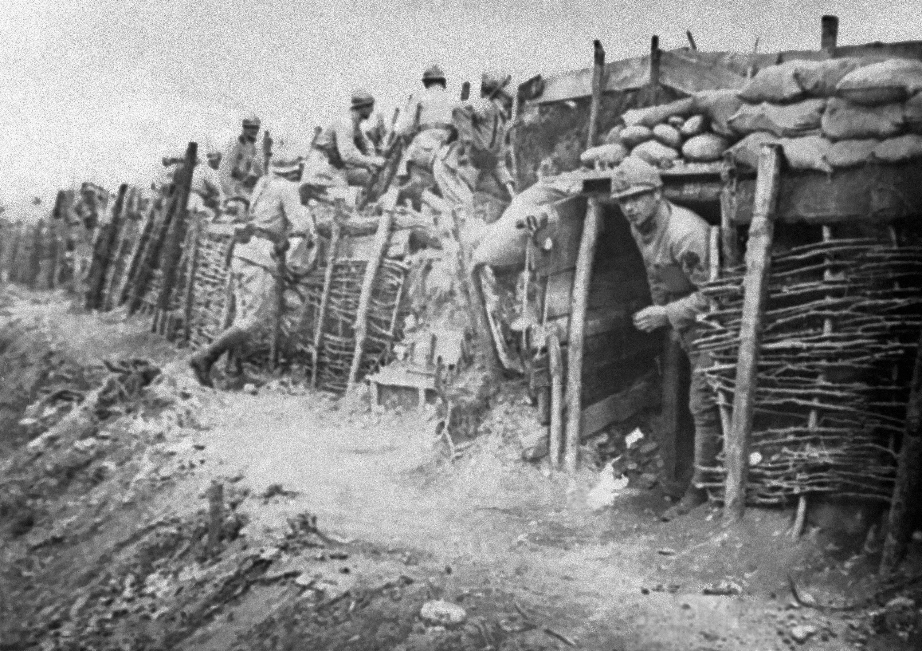 90 OF 100: In this 1918 file photo, Italian army soldiers look out of their dugouts at the Battle of the Piave River, Italy, during World War I. The Battle of the Piave River was fought between June 15-23, 1918.