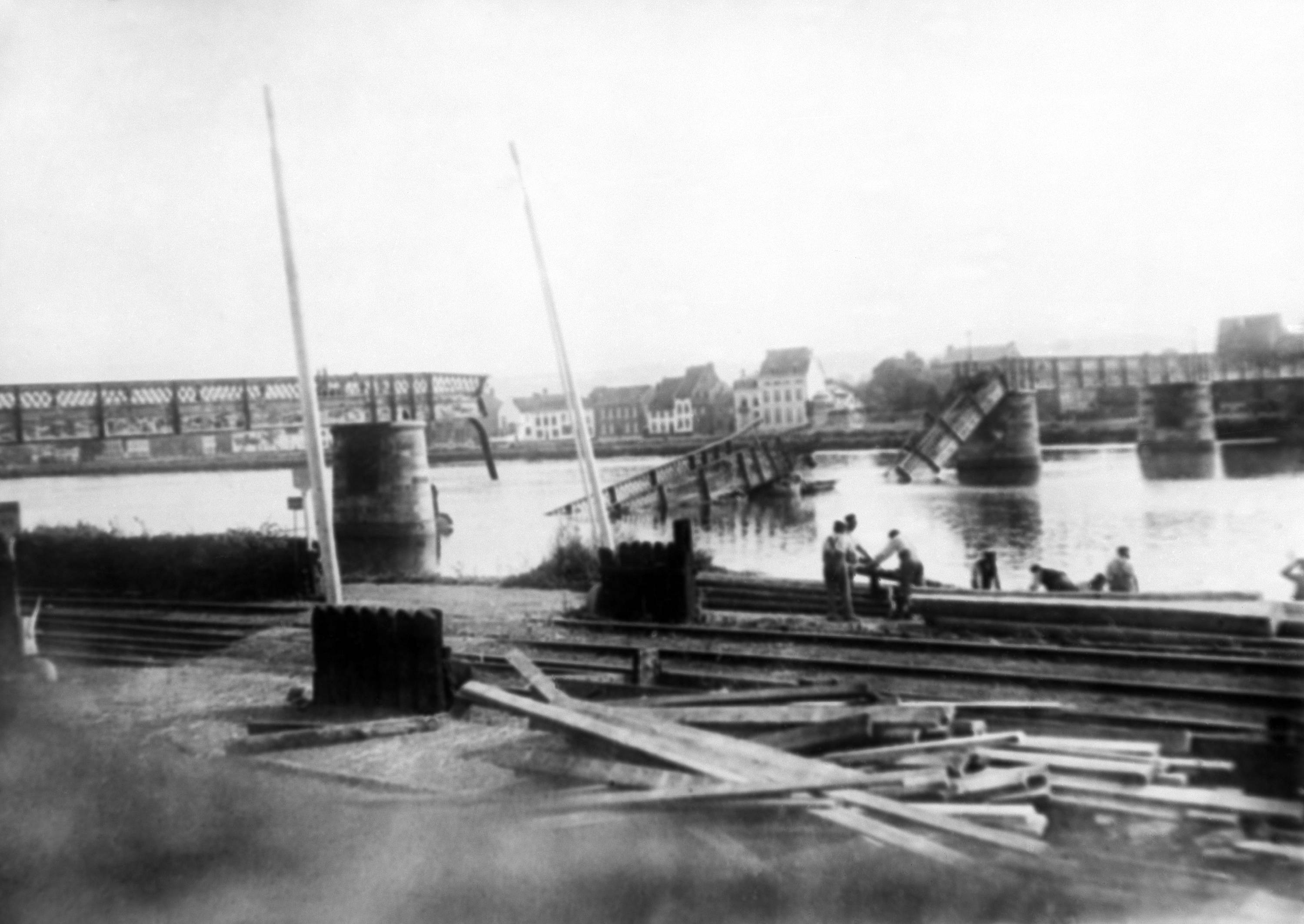 10 OF 100: In this 1914 file photo, a bridge across the Meuse River in Belgium, which was destroyed by retreating Belgian troops, is being rebuilt by invading German troops.