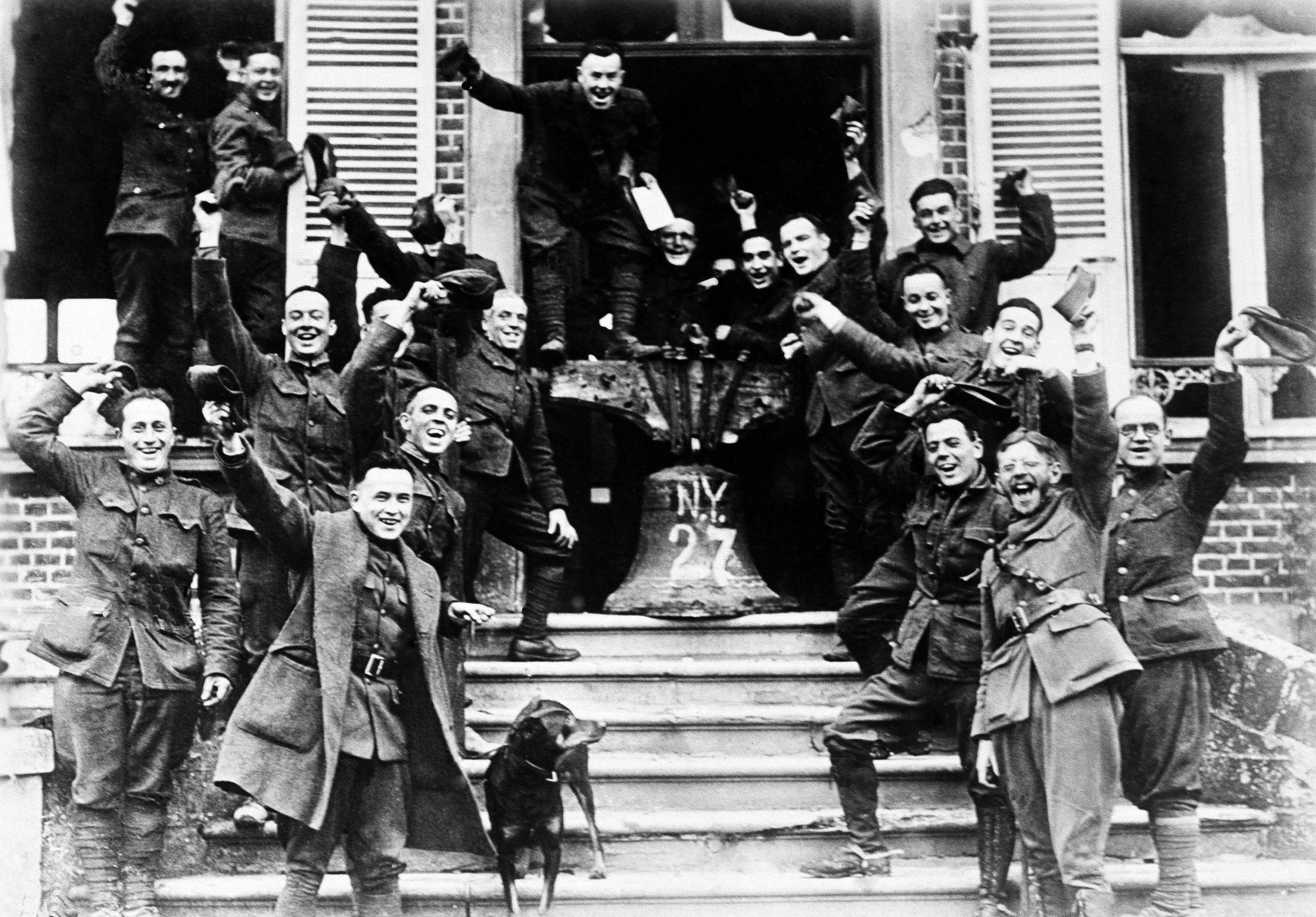 97 OF 100: In this November 1918 file photo, American soldiers from New York, who served on the frontline in Cambria, France, rig up a Liberty Bell to celebrate the signing of the Armistice to end World War I.