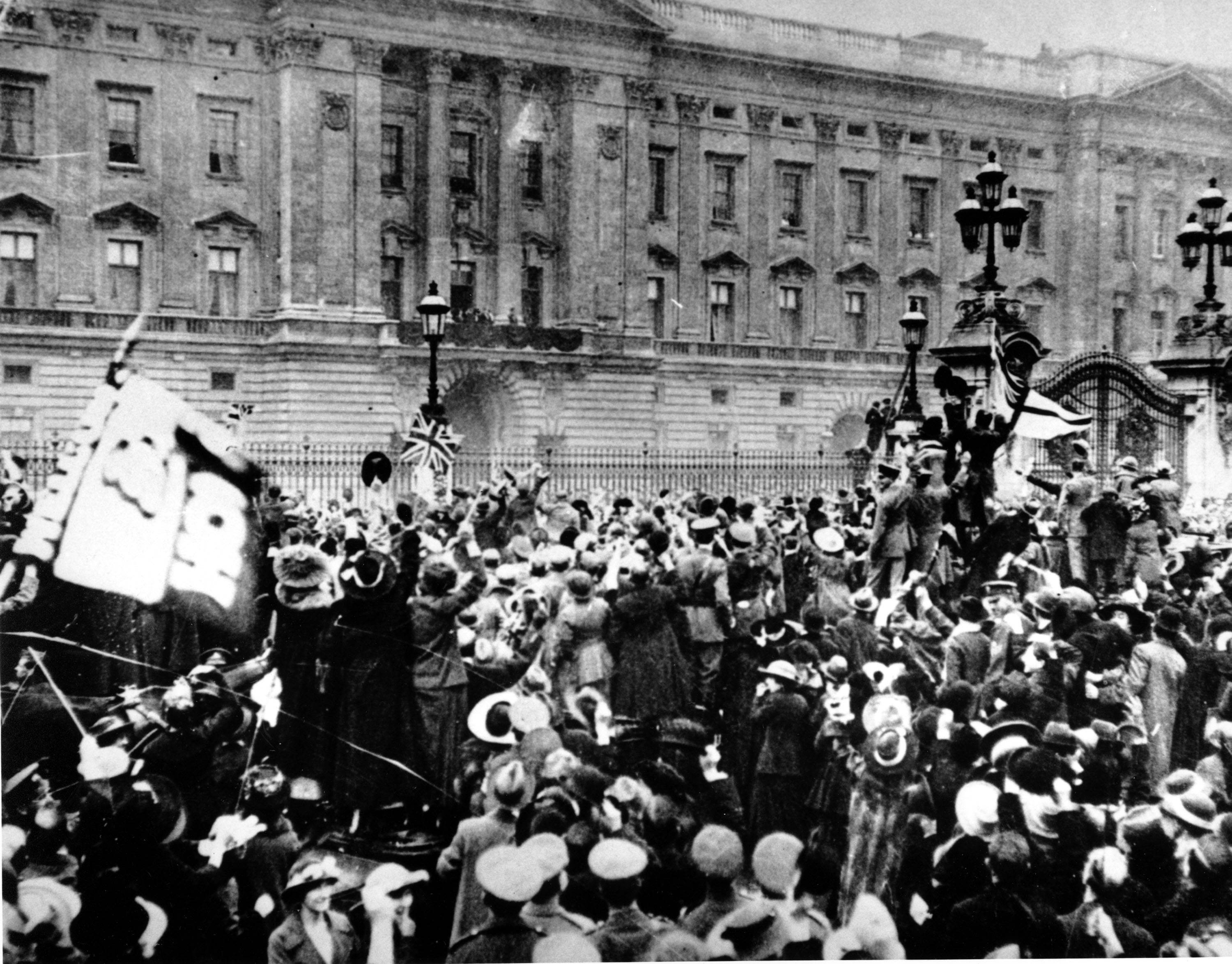 98 OF 100: In this Nov. 11, 1918, file photo, a group of people gather in front of Buckingham Palace in London, England, to celebrate the signing of the Armistice that ended the fighting of World War I.
