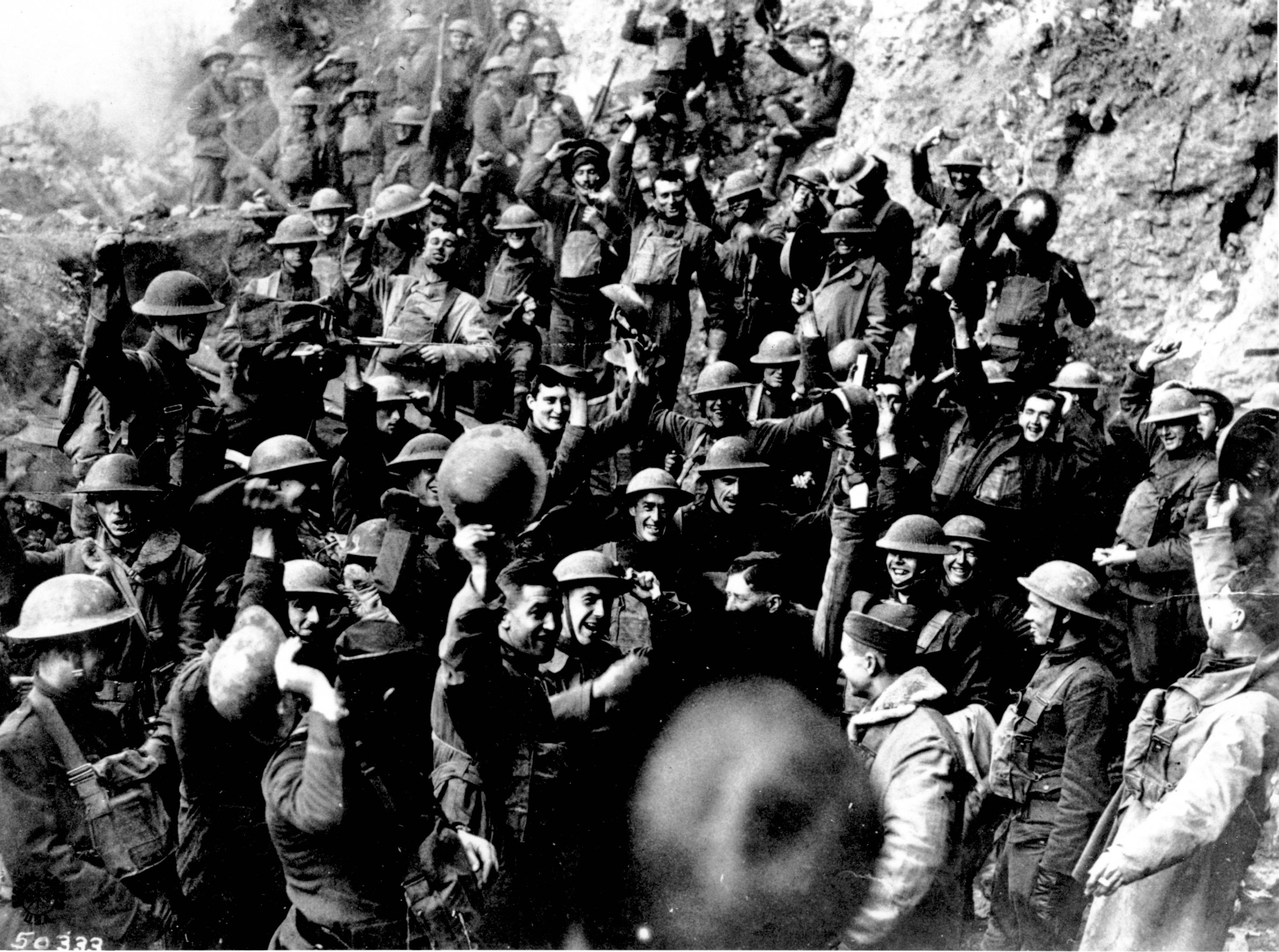 100 OF 100: In this 1918 file photo, American troops, near St. Mihiel, France, cheer after hearing the news that the Armistice has been signed, ending World War I.