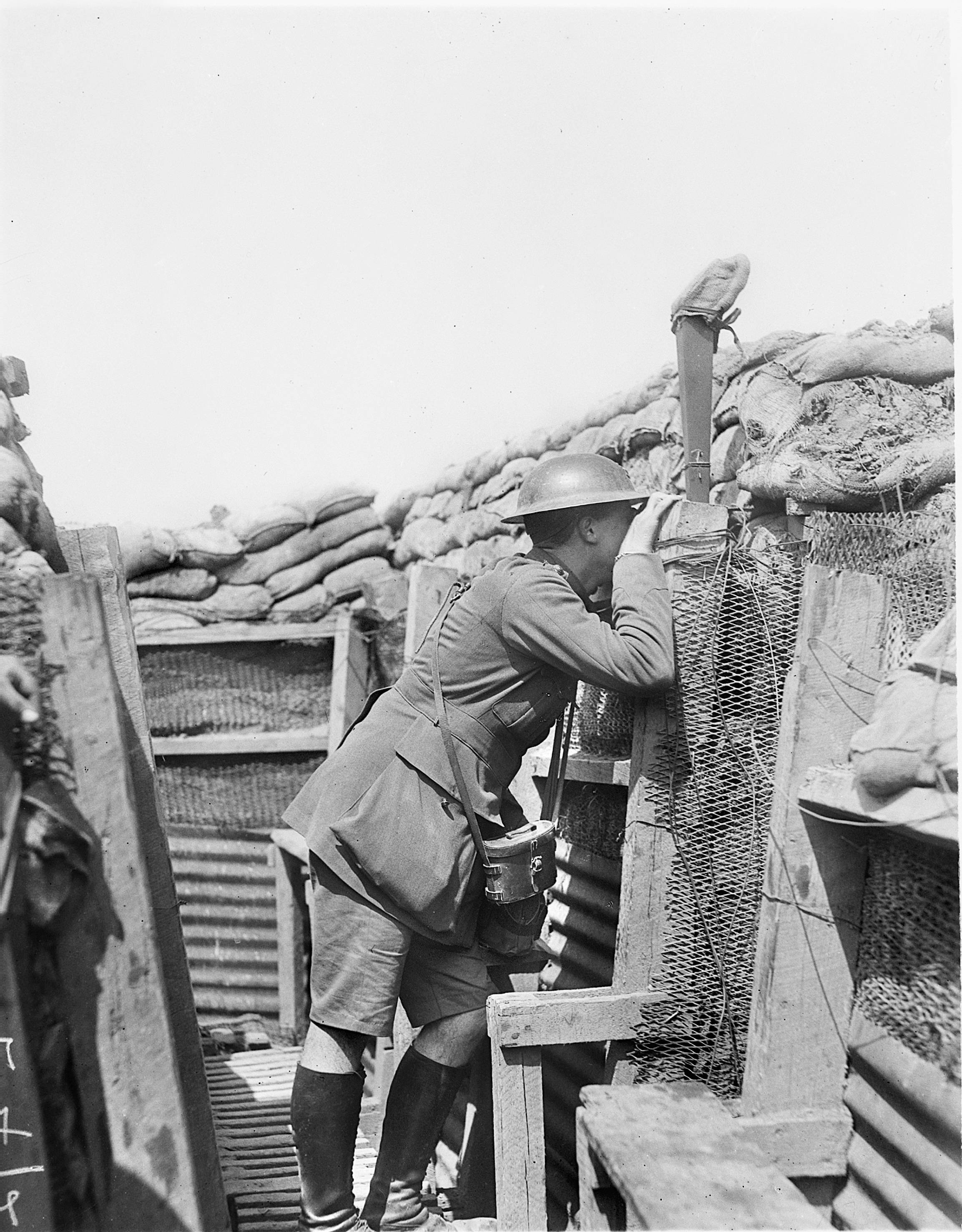 In this June 5, 1917 photo provided by the Australian War Memorial, an Australian officer, in a well constructed trench on Hill 63, looks through a periscope near Messines Ridge in Messines, Belgium. The photograph was taken twelve hours prior to the opening of the long prepared battle, which was eventually to win the position from the enemy.