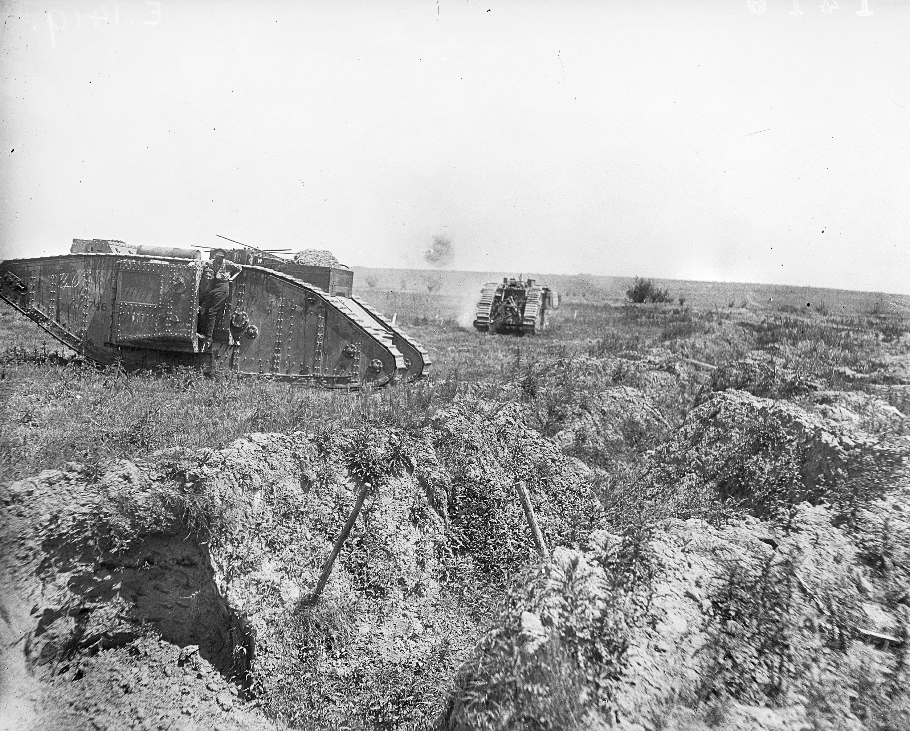 In this June 7, 1917 photo provided by the Australian War Memorial, Australian soldiers man two tanks in action during the attack on Messines Ridge in Messines, Belgium.