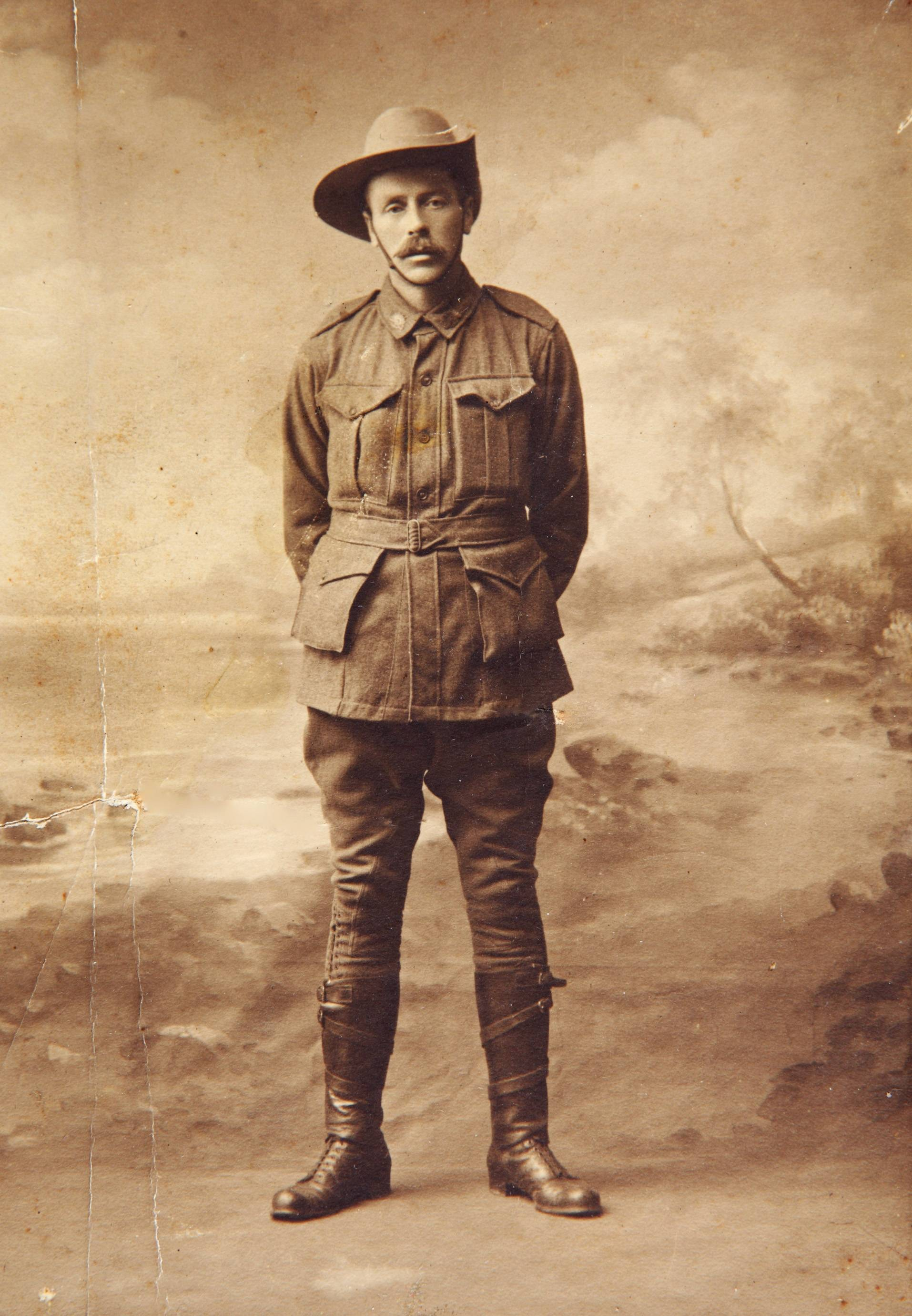 In this undated photo provided by the family, Australian soldier Andrew Bayne poses for a photo before leaving for the Western Front in Brisbane, Australia. Andrew Bayne, along with his brothers, enlisted for service in World War I. Andrew Bayne's journey took him to the battlefields of Bullecourt, Wytschaete, and Ypres before he was killed in action near Messines Ridge, Belgium on Aug. 19, 1917.