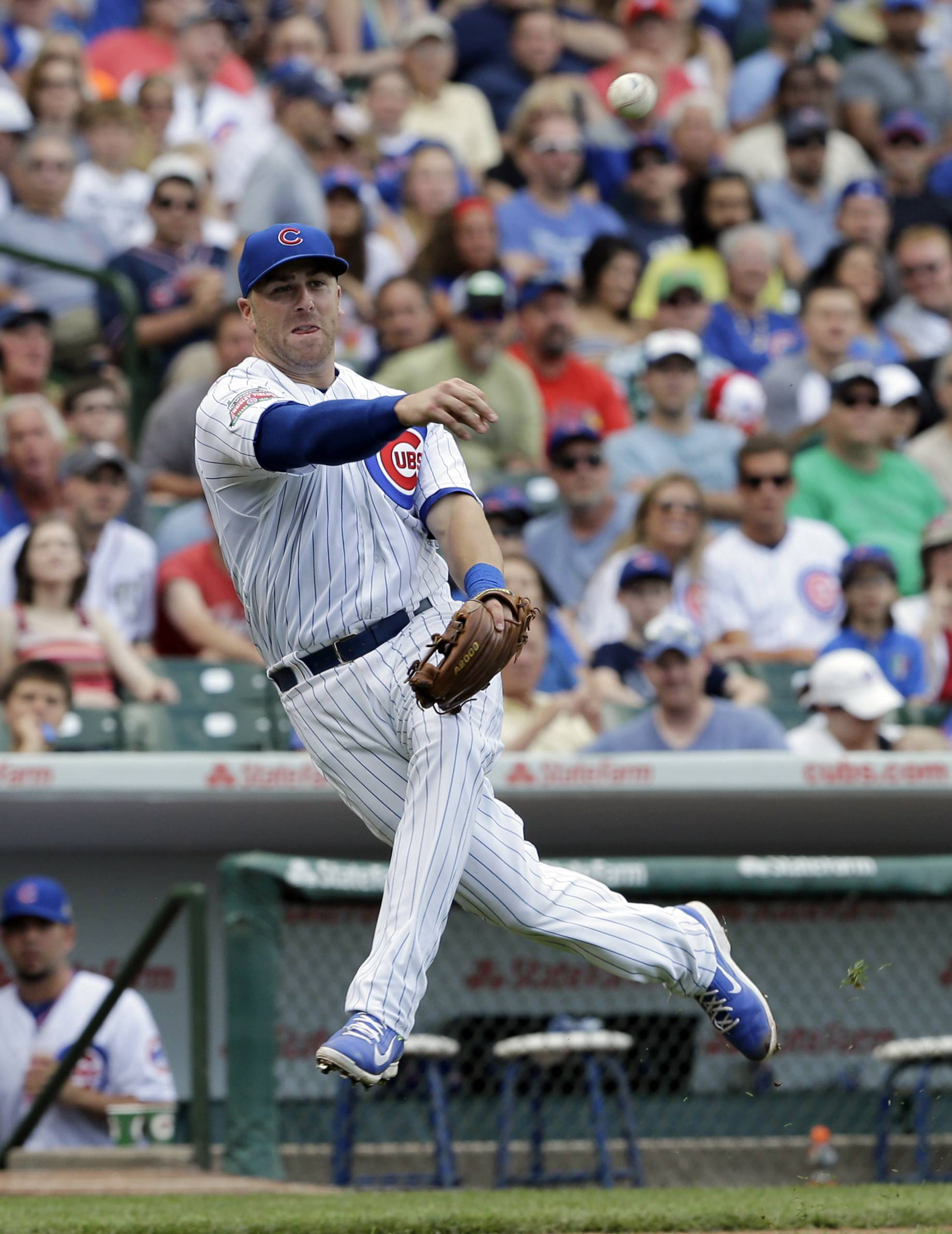 Chicago Cubs third baseman Mike Olt throws to first after Washington Nationals' Denard Span hit a bunt during the sixth inning of a baseball game Saturday at Wrigley Field.