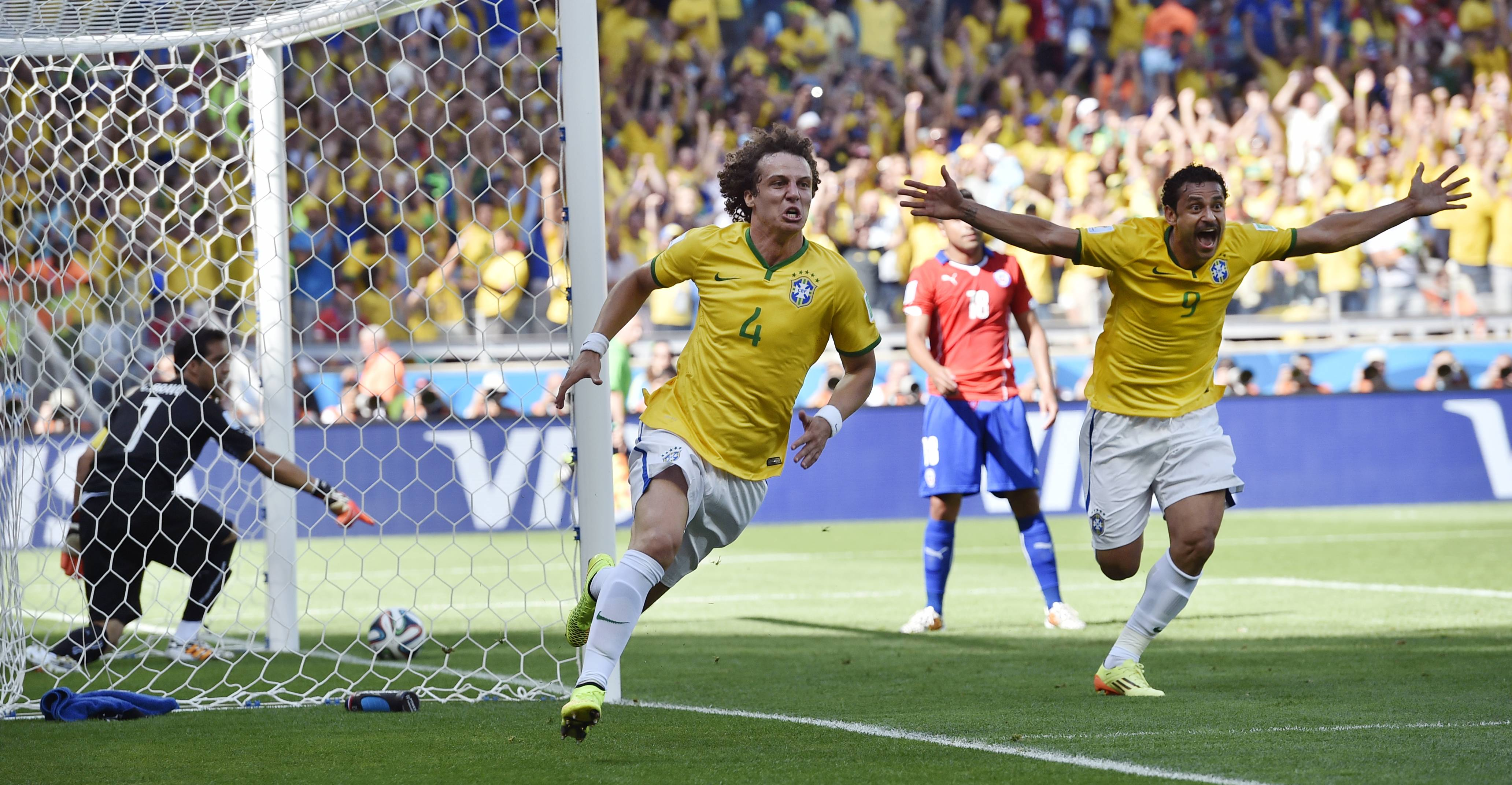Brazil's David Luiz, left, and Fred celebrate after Brazil's opening goal during the World Cup round of 16 soccer match between Brazil and Chile at the Mineirao Stadium in Belo Horizonte, Brazil, Saturday.