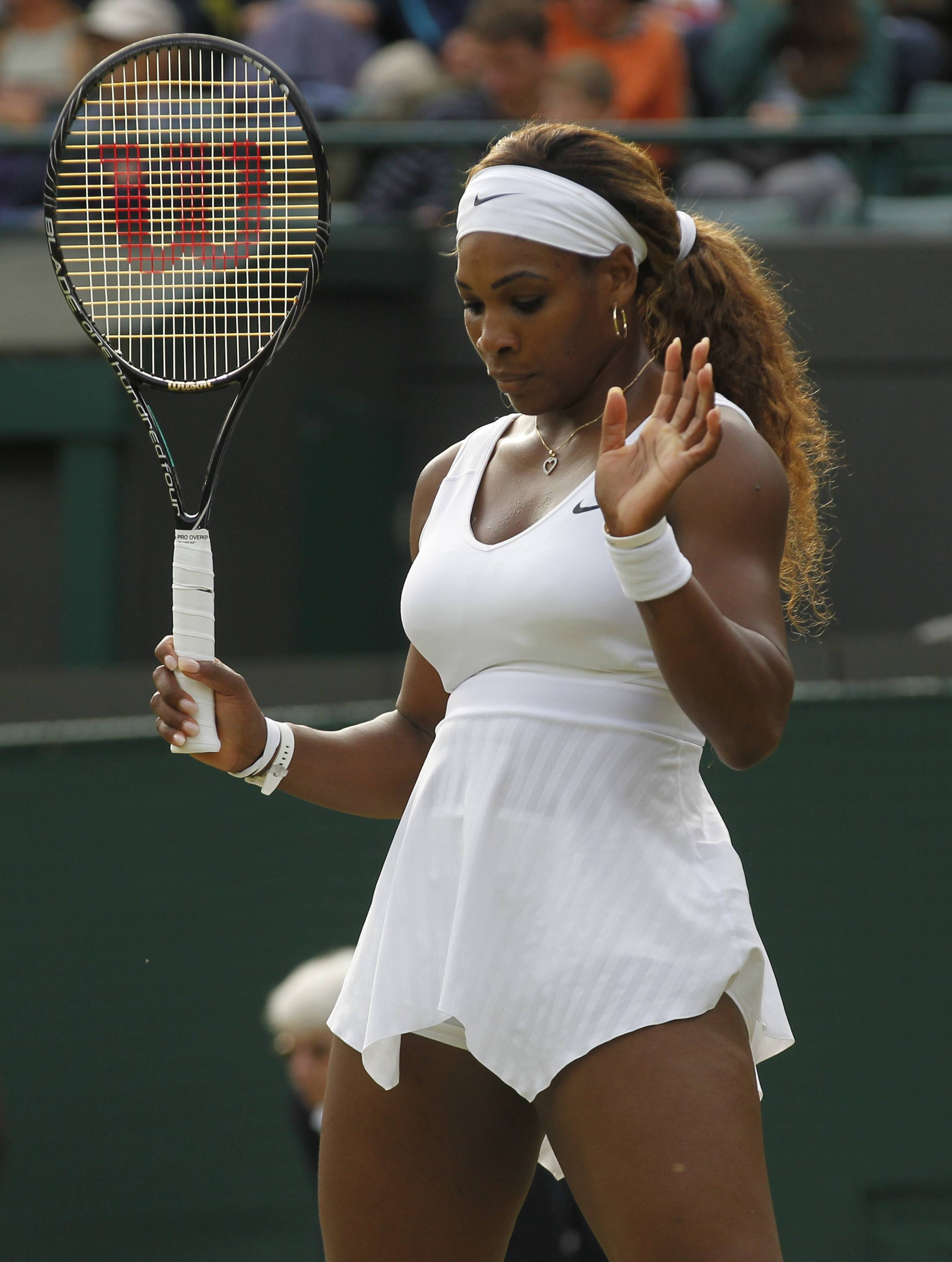 Serena Williams gestures Saturday during her women's singles match against Alize Cornet of France.