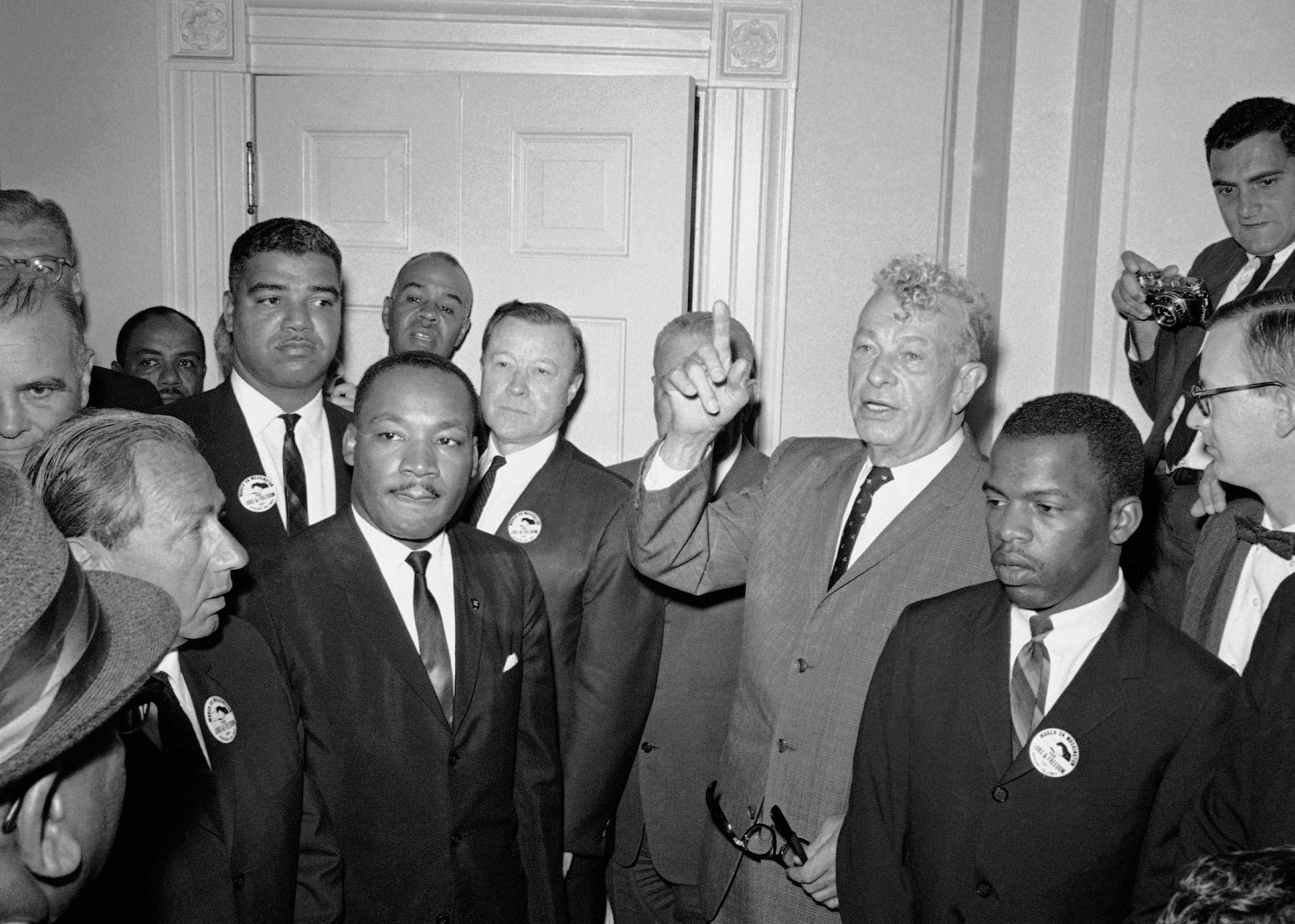 Leaders of the March on Washington stand with Illinois Sen. Everett Dirksen, center right, during a visit to the Capitol on Aug. 28, 1963. From left are Whitney Young, National Urban League; Martin Luther King Jr., Southern Christian Leadership Conference; Roy Wilkins, NAACP, behind King; Walter Reuther, United Auto Workers president; Dirksen and John Lewis, Student Non Violent Coordinating Committee. (AP Photo)
