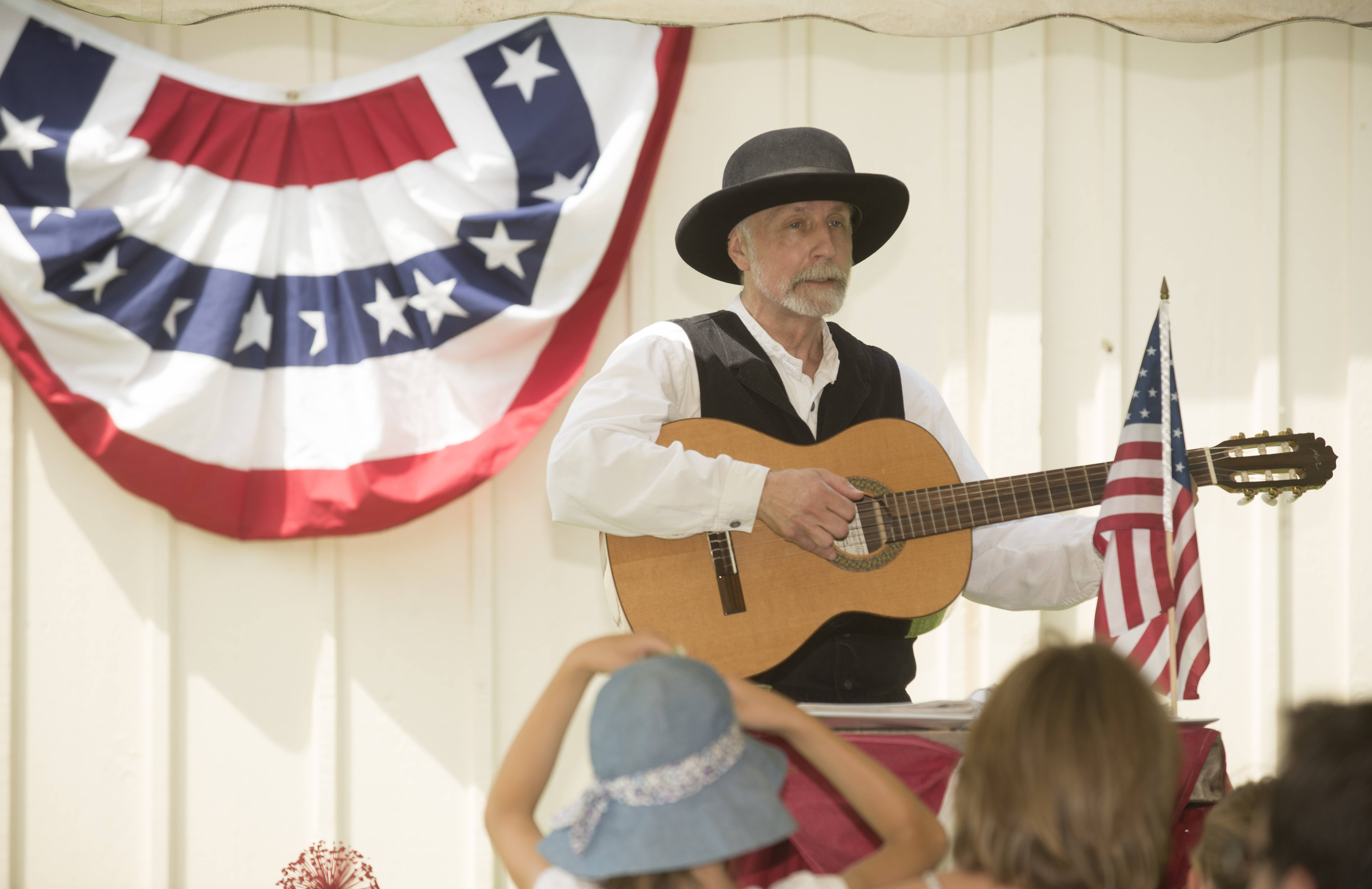 Roger Koteckr sings 1890s patriotic music Sunday during Kline Creek Farm's old-fashioned 4th of July event.