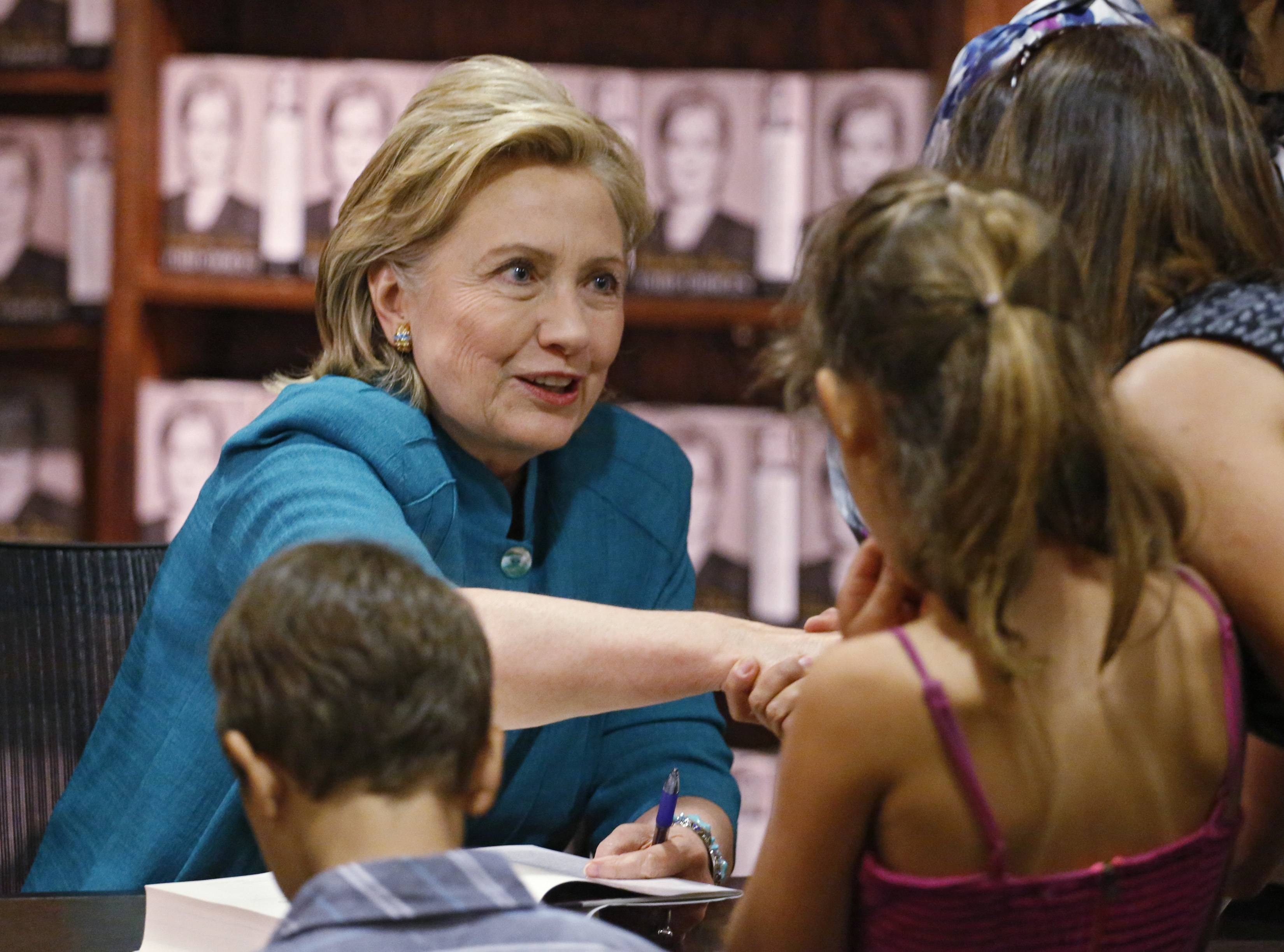 "Former Secretary of State Hillary Rodham Clinton greets fans at a book signing for her new book ""Hard Choices,"" her recounting of her time as President Barack Obama's top diplomat, at the Tattered Cover Book store in Denver on Monday, June 23, 2014."