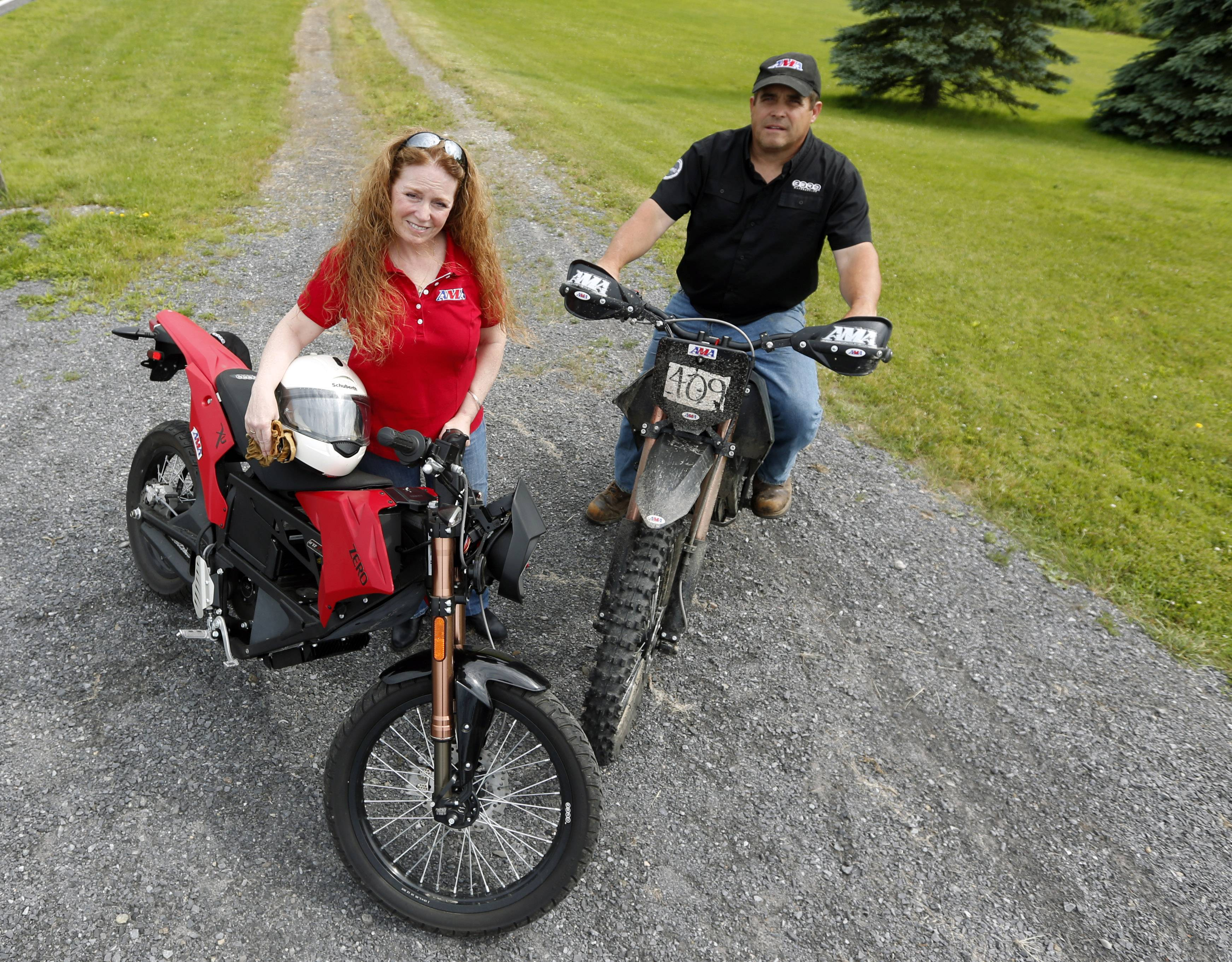 Maggie McNally-Bradshaw and her husband Curt Bradshaw pose with their Zero electric motorcycles in Princetown, N.Y. Startups like Zero, Brammo and Mission are making state-of-the-art electric motorcycles on the West Coast. Harley-Davidson's unveiling of its prototype electric motorcycle LiveWire is likely to give a boost to smaller companies already producing plug-in bikes.