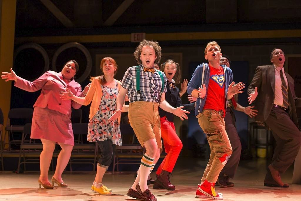 "William Barfée (Eli Branson, center) leads the cast in a song about his magic spelling foot in ""The 25th Annual Putnam County Spelling Bee"" at Drury Lane Theatre in Oakbrook Terrace, which runs through Aug. 17."