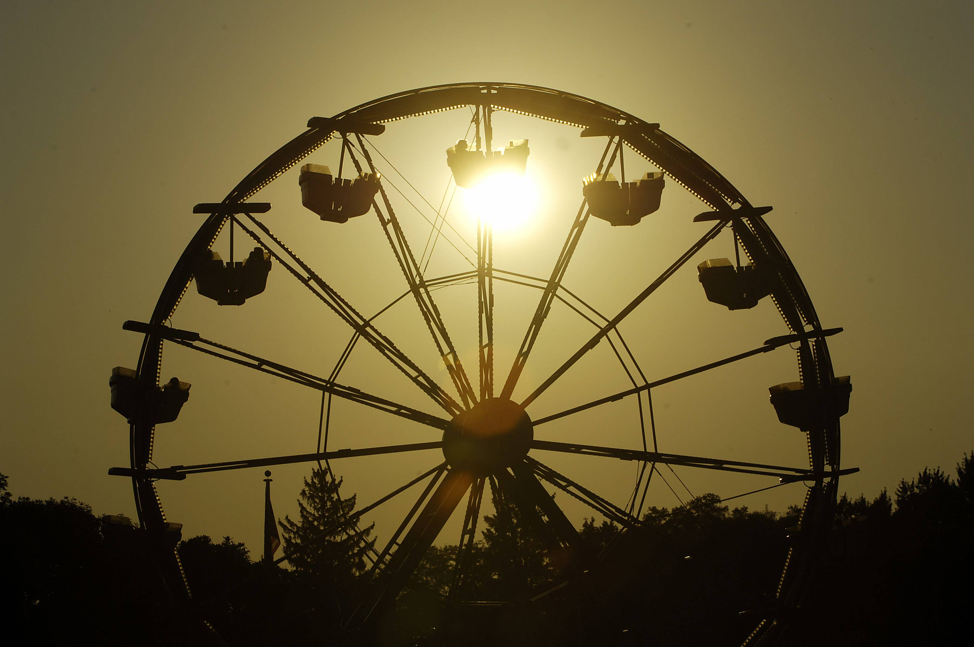 The sun sets on the opening night of South Elgin's Riverfest Express Thursday.