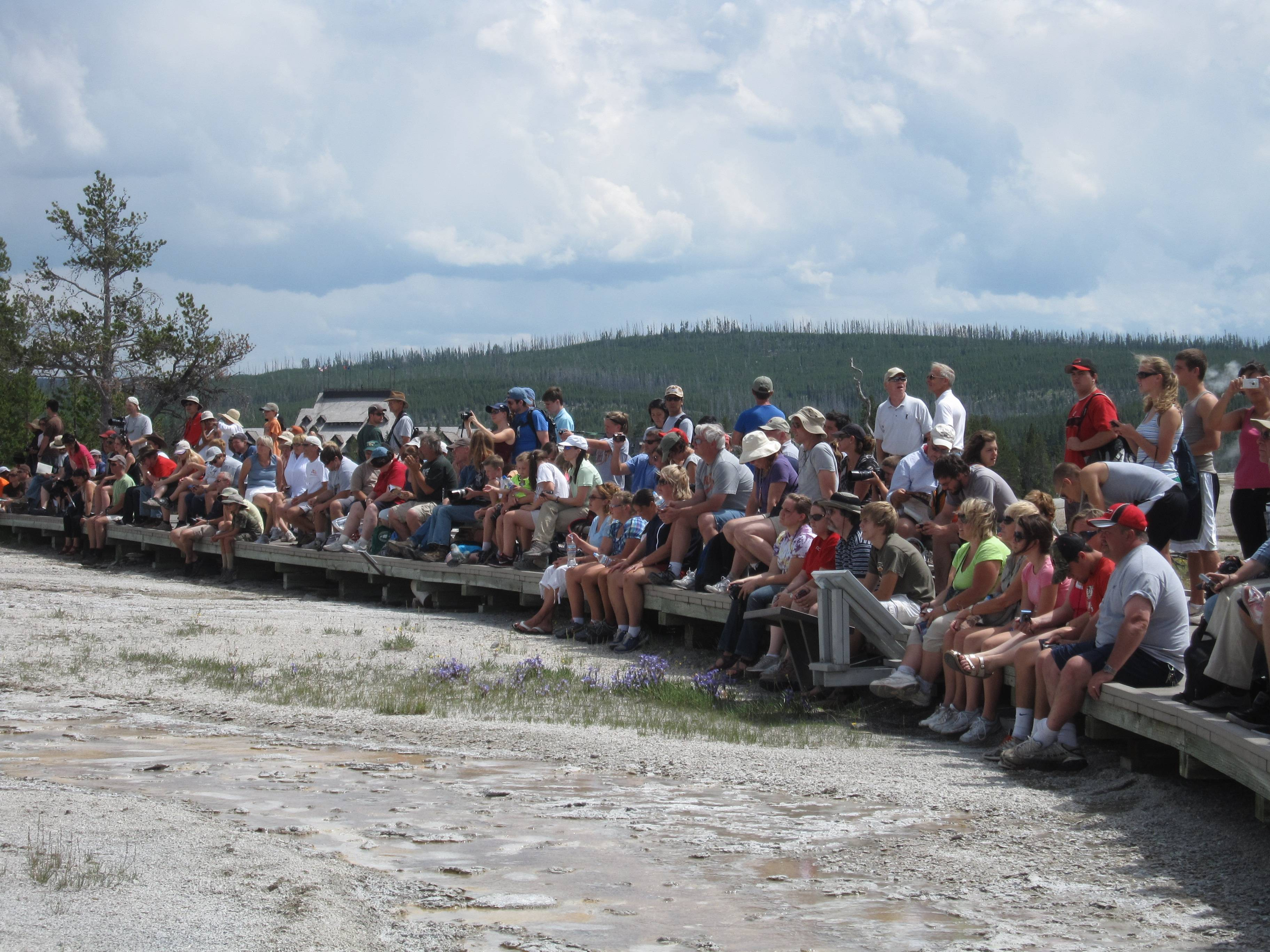 Tourists await the eruption of Grand Geyser in Yellowstone National Park in Wyoming. It's the tallest predictable geyser in the world, reaching 150 feet to 200 feet high, and one of a number of geysers that are concentrated along a 10-mile stretch in the park.