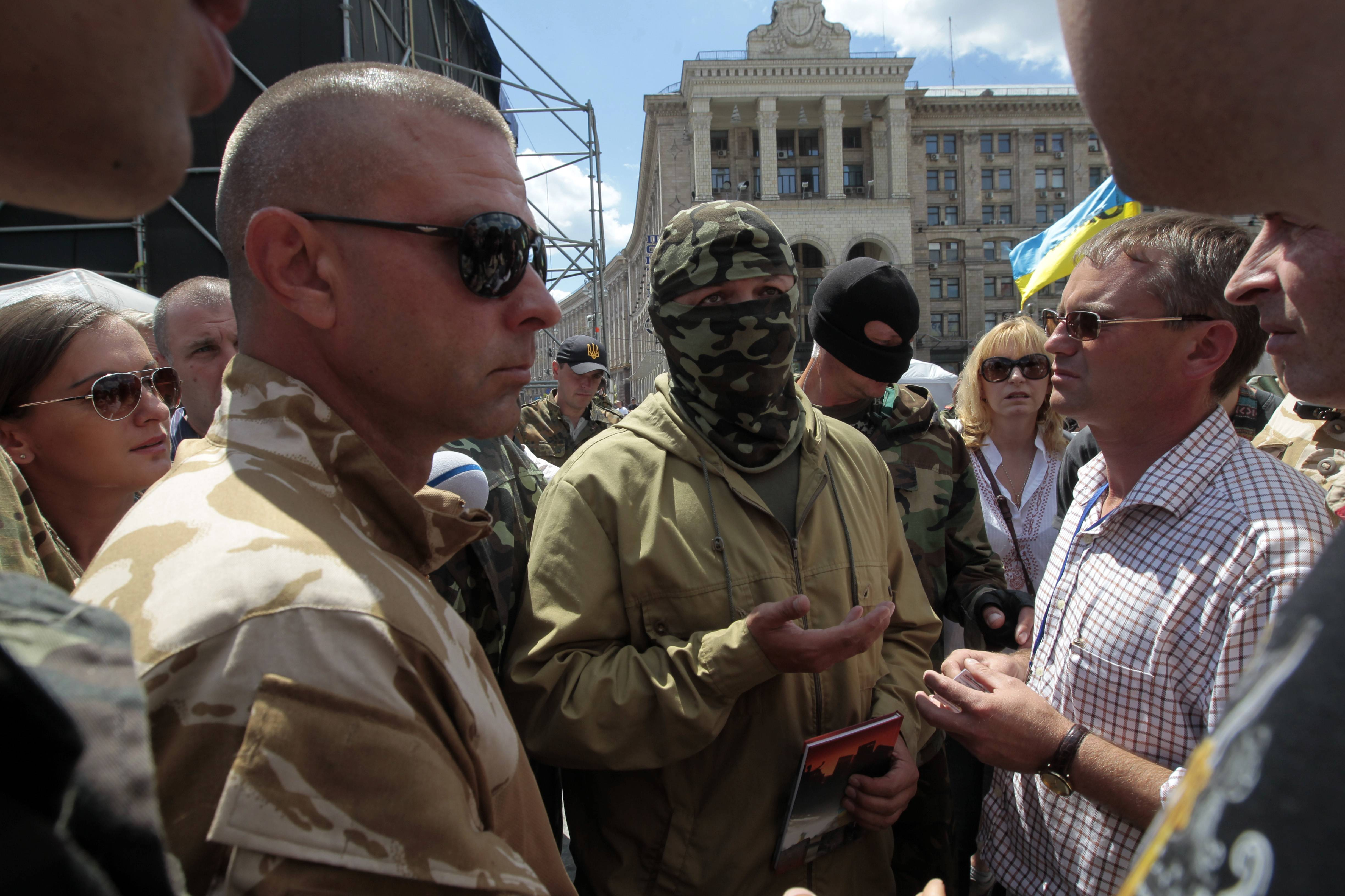 "Semen Sementchenko, center, commander of the ""Donbass"" battalion of Ukraine, attends a rally in Independence Square in Kiev Sunday. Hundreds of people came Sunday morning to the presidential administration to demand a stop to the cease fire on the eastern part of Ukraine."