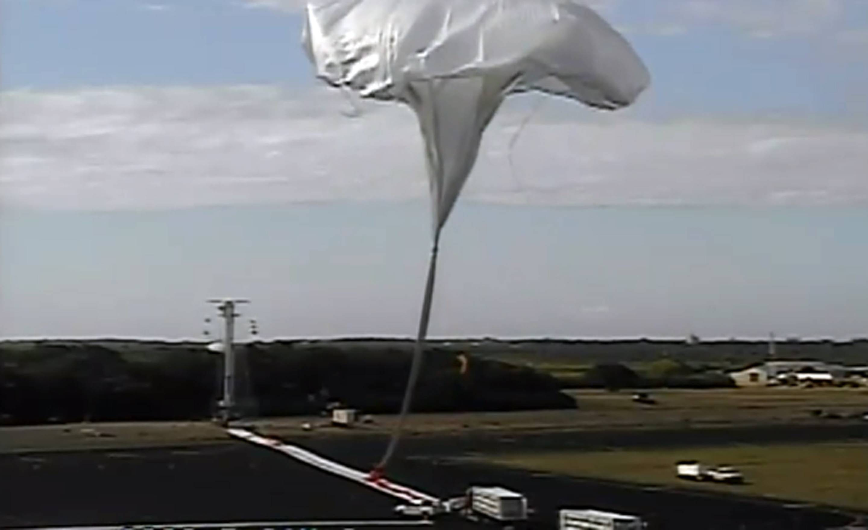 This image taken from video provided by NASA shows the launch of the high-altitude balloon carrying a saucer-shaped vehicle for NASA, to test technology that could be used to land on Mars Saturday in Kauai, Hawaii.