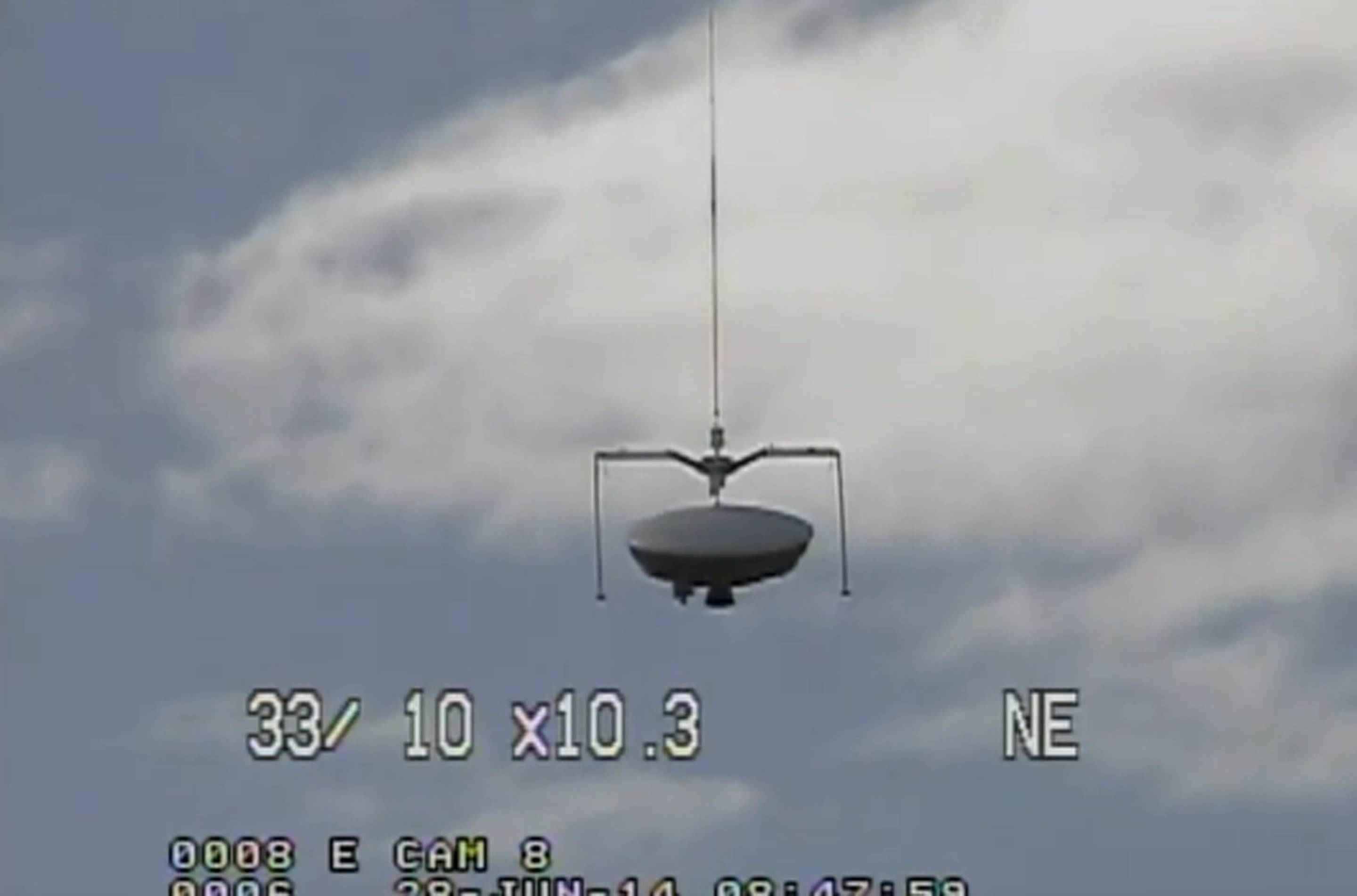 This image taken from video provided by NASA shows the launch of the high-altitude balloon carrying this saucer-shaped vehicle for NASA Saturday in Kauai, Hawaii. Saturday's experimental flight high in Earth's atmosphere is testing technology that could be used to land on Mars.