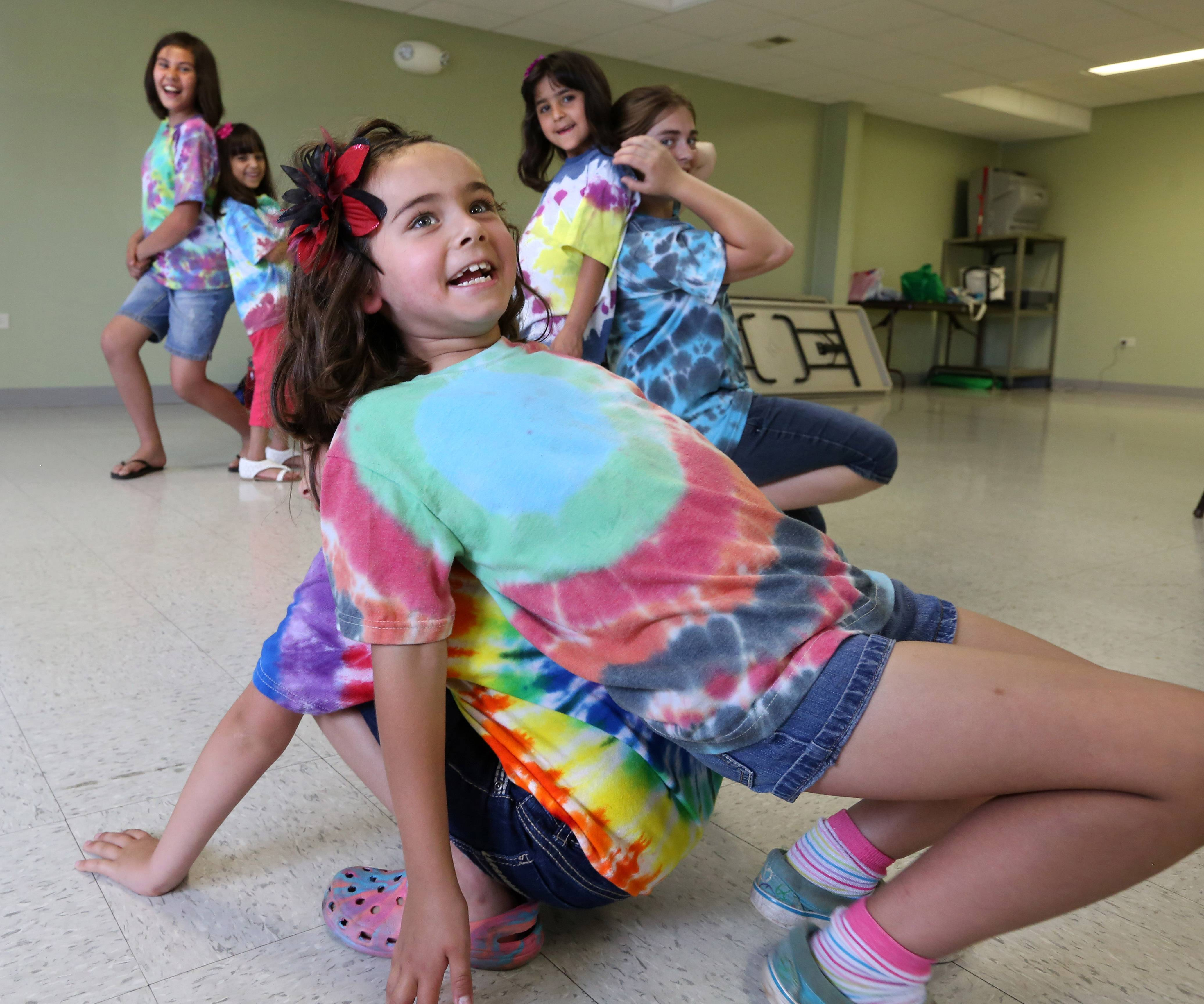 Girl Scouts and 5-year-old Vernon Hills twins Alexys DeYoung, right, and Kaylah, belong to Troop 40735. Here, they play at a recent meeting in donated space at Fremont Township government's building near Mundelein.