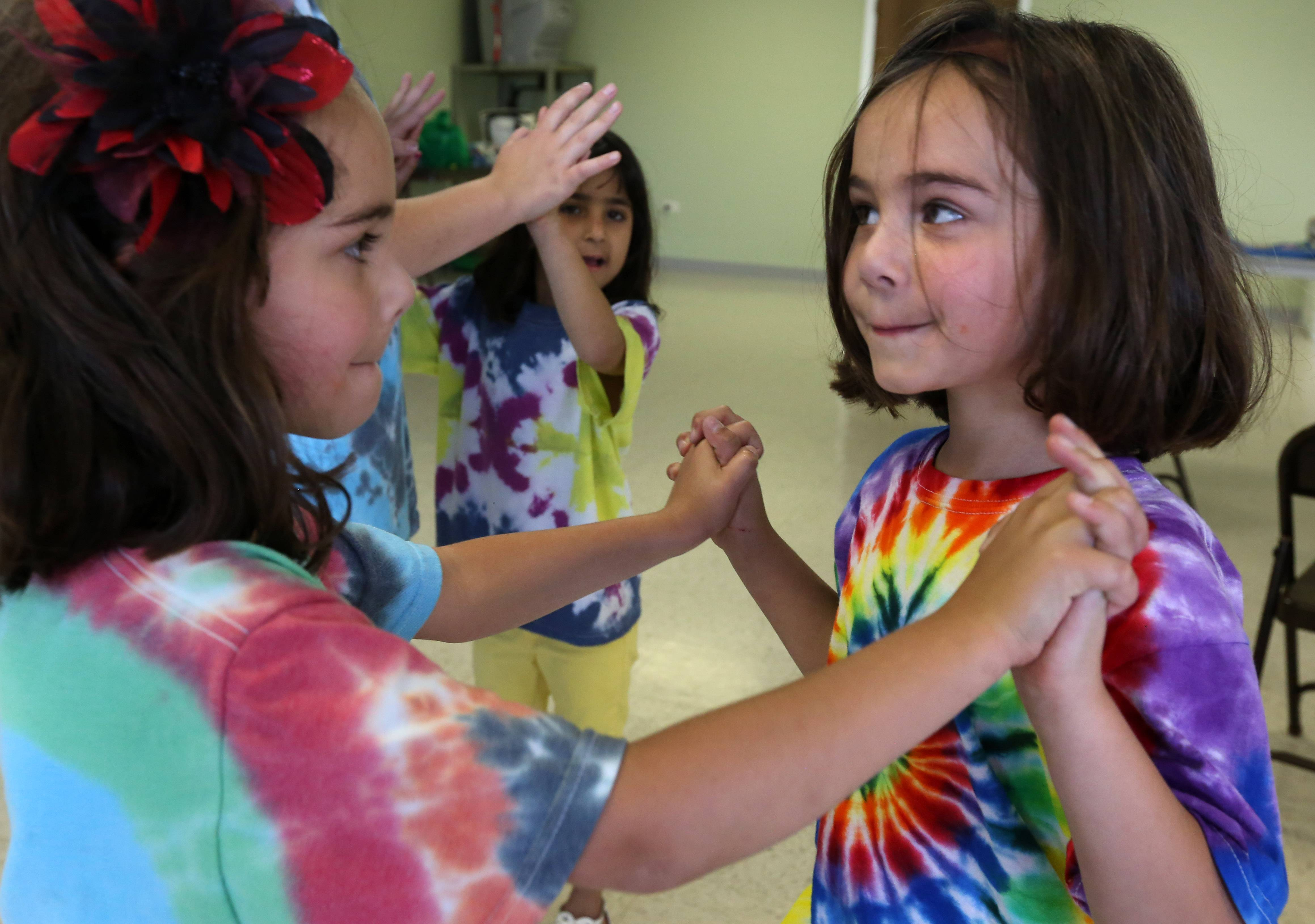 Five-year-old Vernon Hills twins Kaylah DeYoung, right, and Alexys belong to Girl Scout Troop 40735. They attended a recent meeting at Fremont Township government's building where they joined other girls in games and other activities.