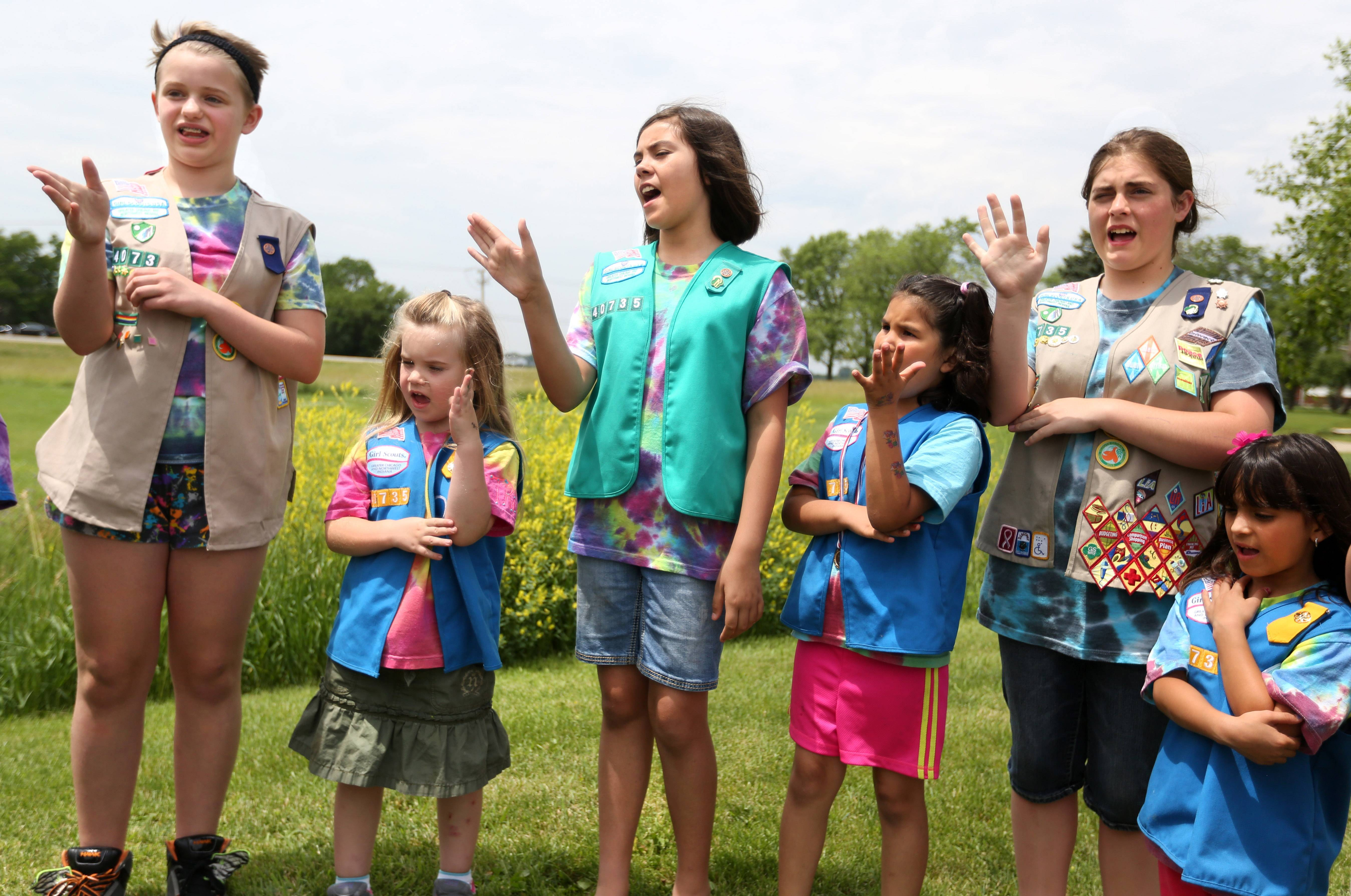 Girl Scouts with Troop 40735, sign the Pledge of Allegiance in front of a U.S. flag outside Fremont Township government headquarters near Mundelein. The troop is geared toward girls who are deaf or hard of hearing,