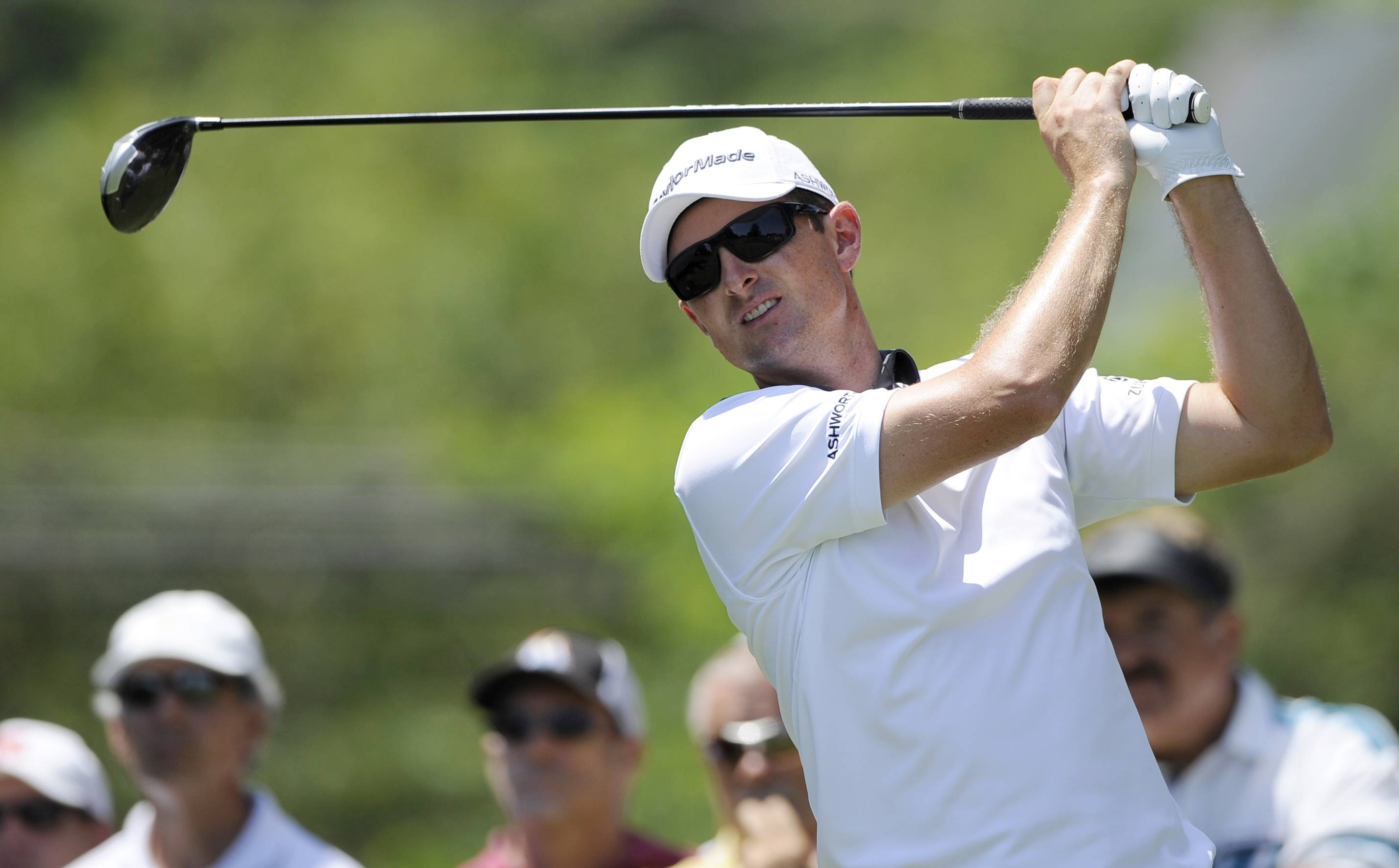 Justin Rose, of England, watches his tee shot on the third tee during the final round of the Quicken Loans National golf tournament, Sunday, June 29, 2014, in Bethesda, Md.