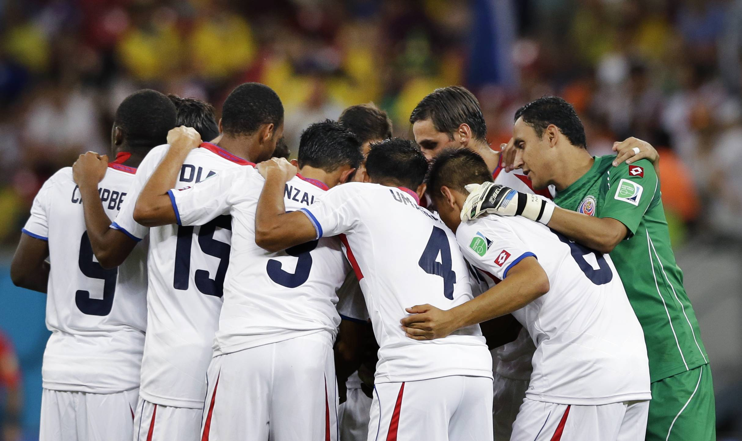 Costa Rica players form a team huddle before the start of the second half during the World Cup round of 16 soccer match between Costa Rica and Greece at the Arena Pernambuco in Recife, Brazil, Sunday, June 29, 2014.