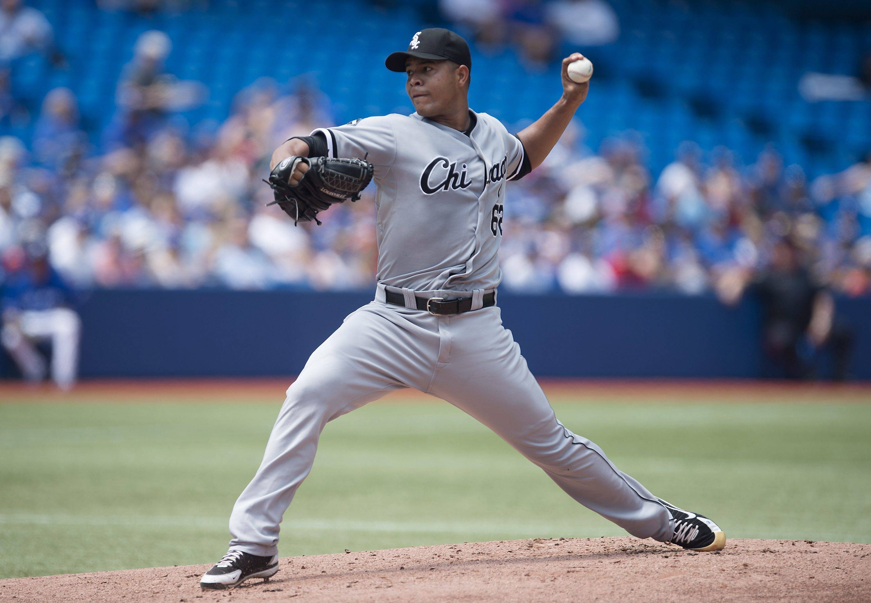 Chicago White Sox starting pitcher Jose Quintana works against the Toronto Blue Jays during the first inning of a baseball game in Toronto on Sunday, June 29, 2014.