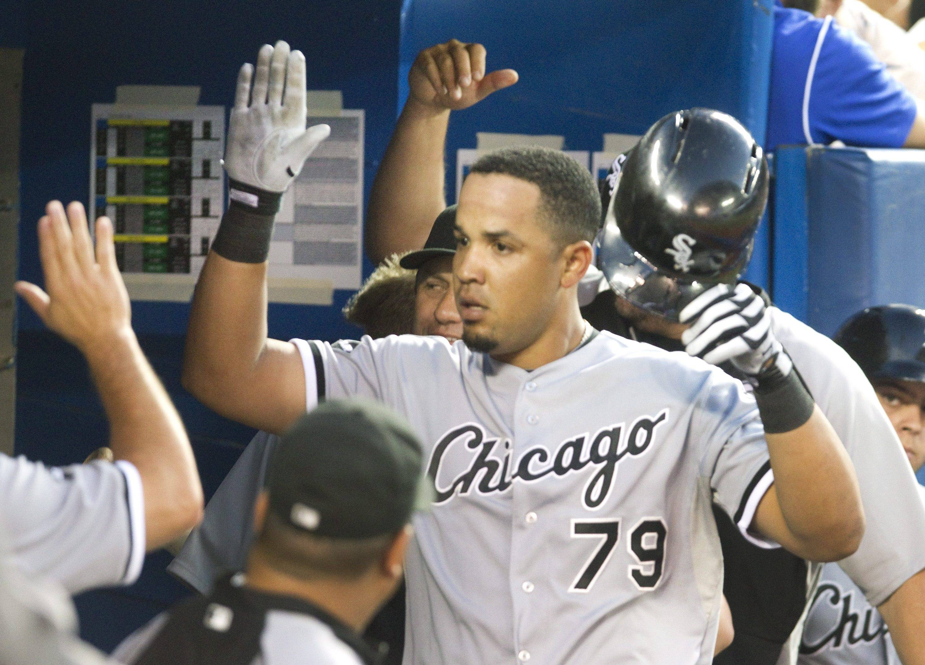White Sox's Jose Abreu is congratulated in the dugout after he hit his second home run of the night off Toronto Blue Jays starting pitcher R.A. Dickey during the seventh inning of their baseball game Friday in Toronto. Abreu is tied for the league lead in home runs and is a bona fide slugger.