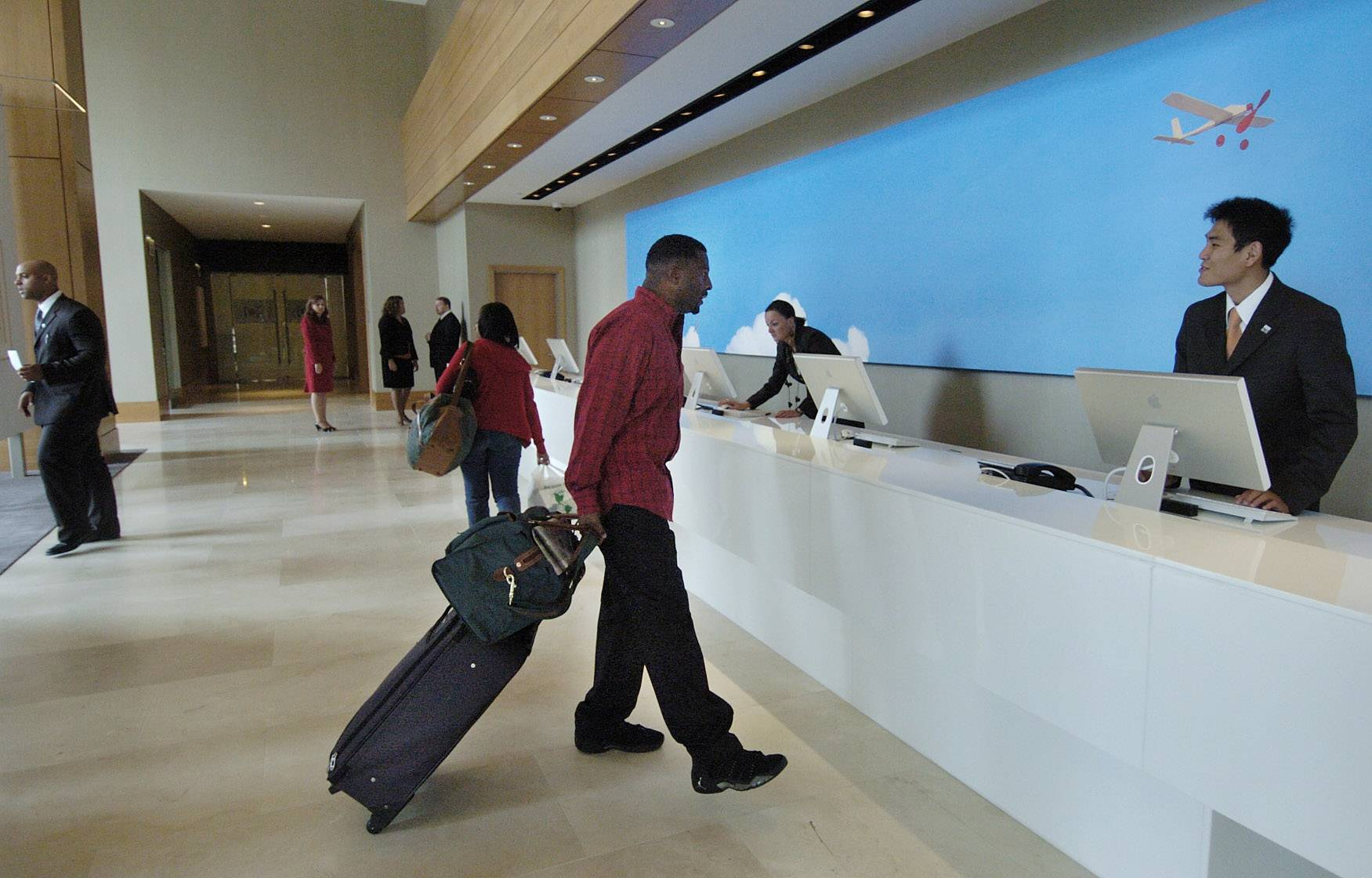 Darryl Coffee of Gary, Ind., left, checks out after spending the weekend at the Intercontinental Chicago O'Hare Hotel in Rosemont in this file photo.