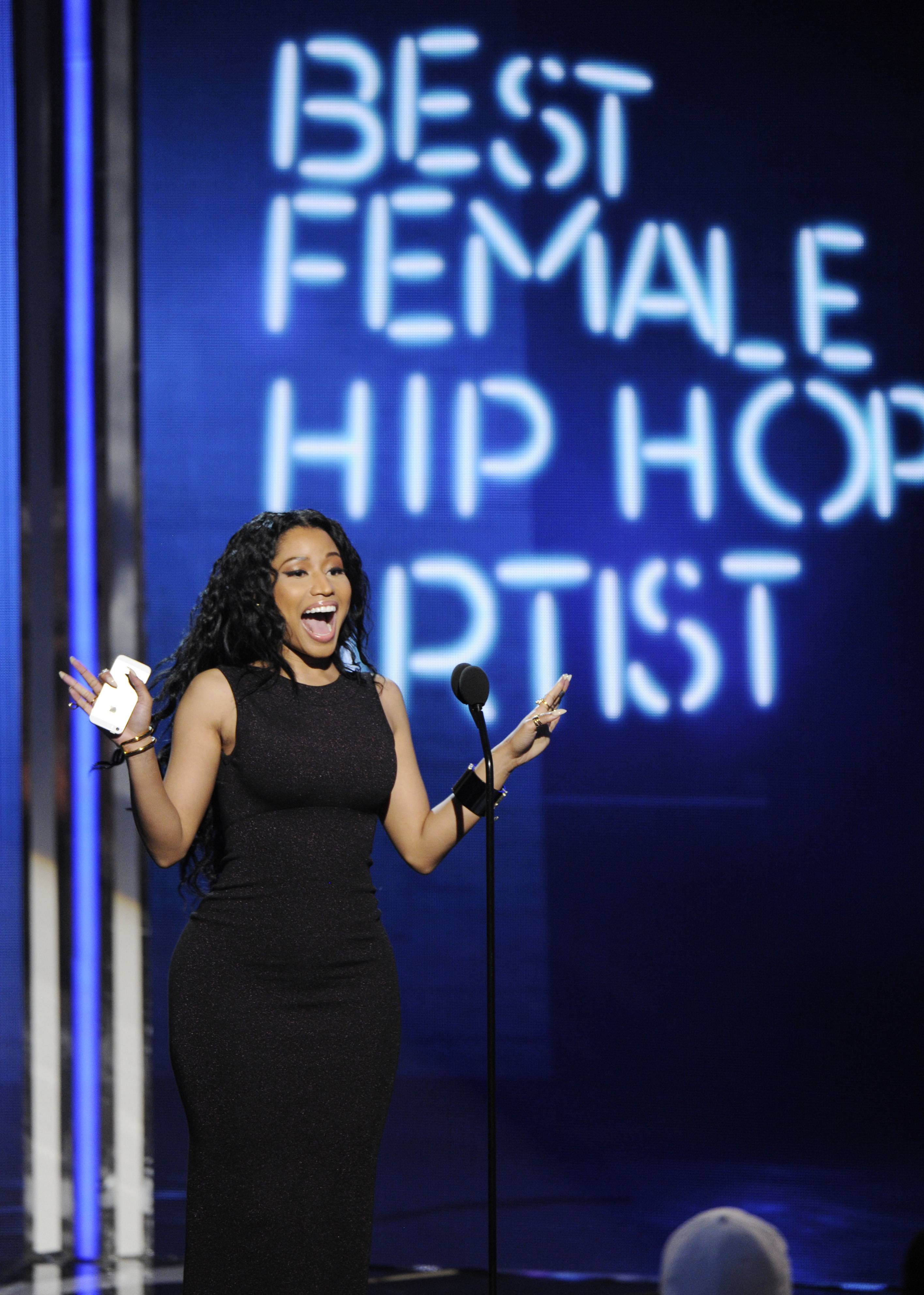 Nicki Minaj accepts the award for best female hip-hop artist at the BET Awards at the Nokia Theatre on Sunday in Los Angeles.