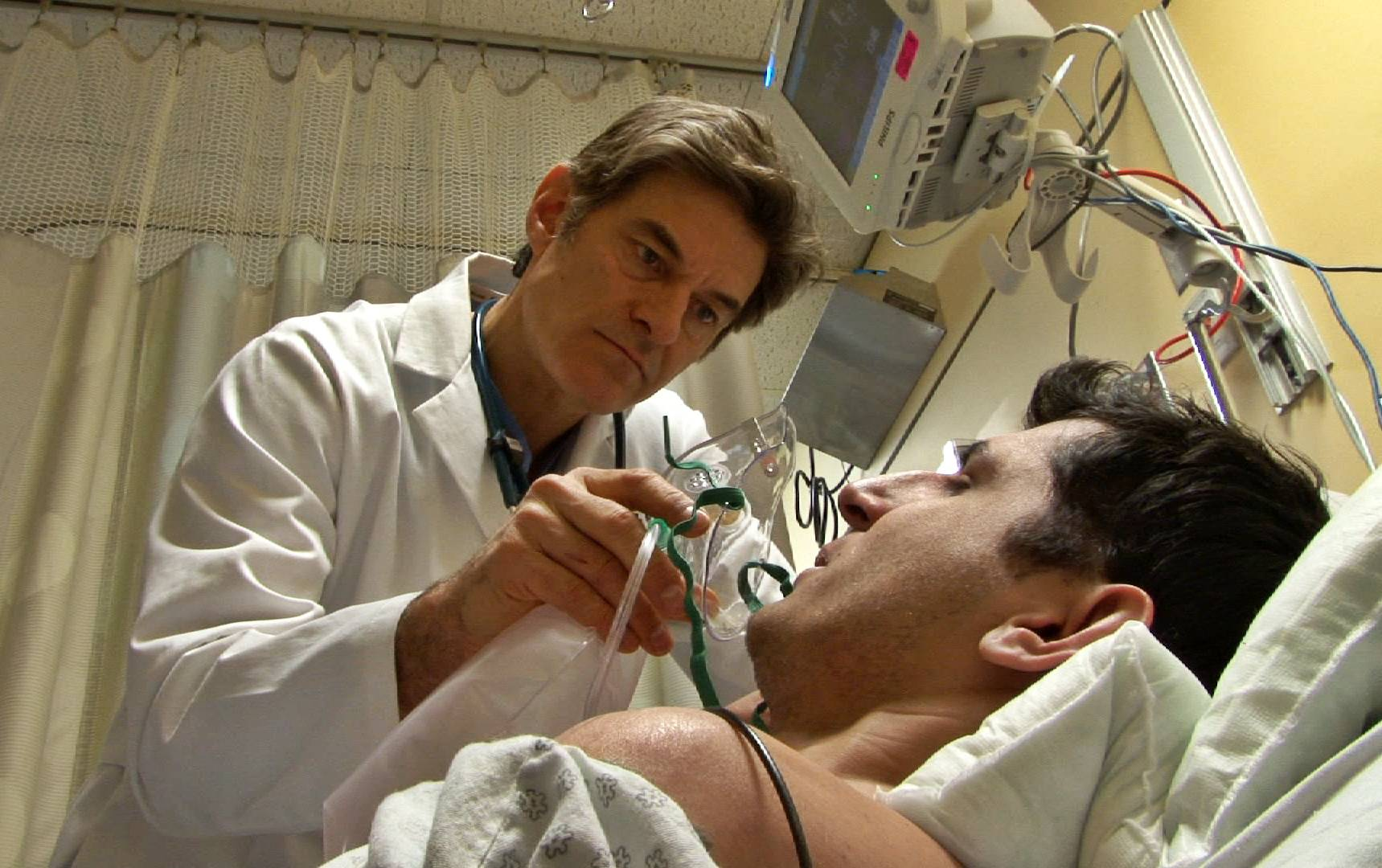 "Dr. Mehmet Oz works with a patient in a scene from the new season of ""NY Med."""
