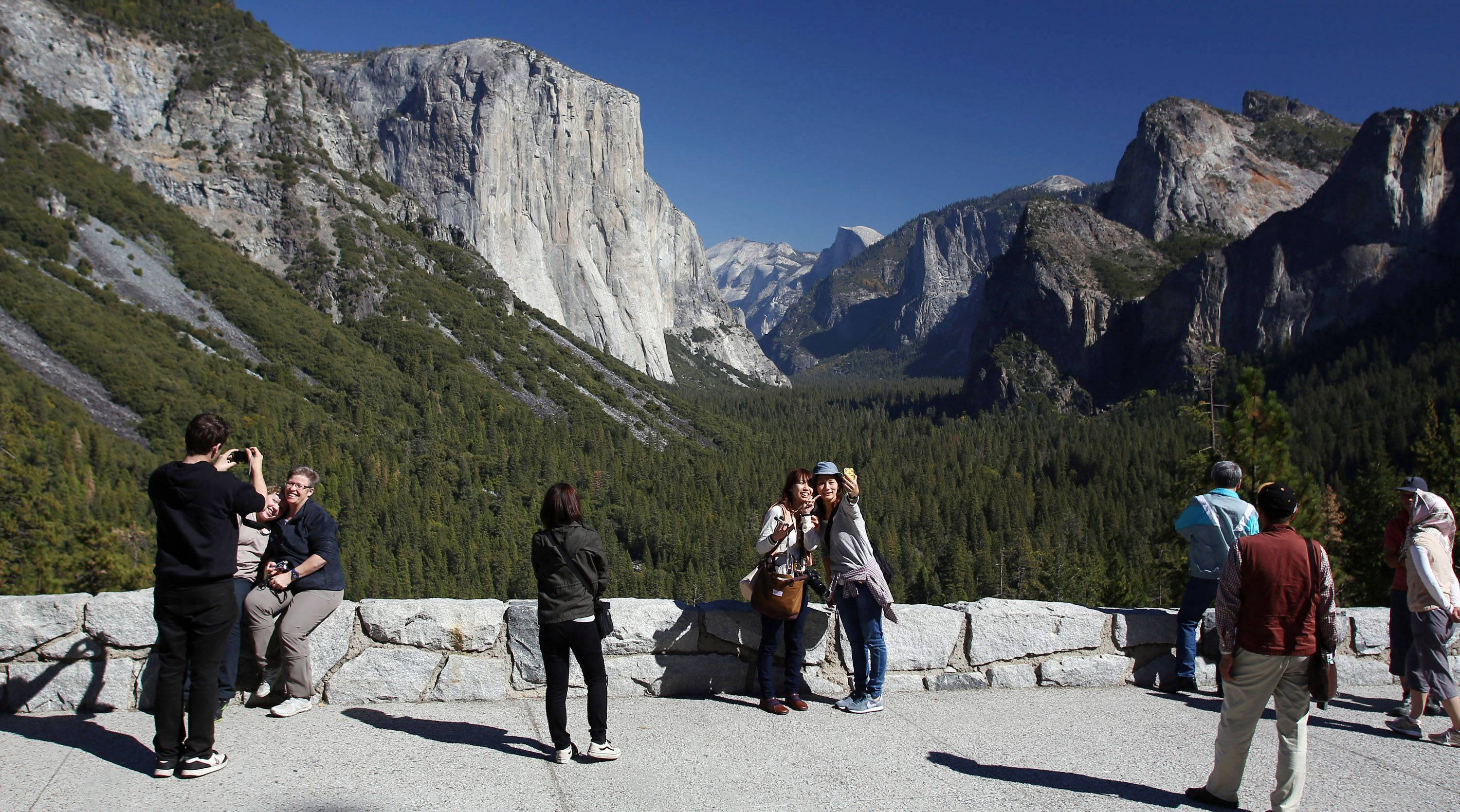 Visitors at Tunnel View enjoy the views of Yosemite National Park, Calif. Tunnel View is a scenic vista which shows off El Capitan, Half Dome and Bridalveil Fall. Yosemite National Park is celebrating the 150th anniversary.