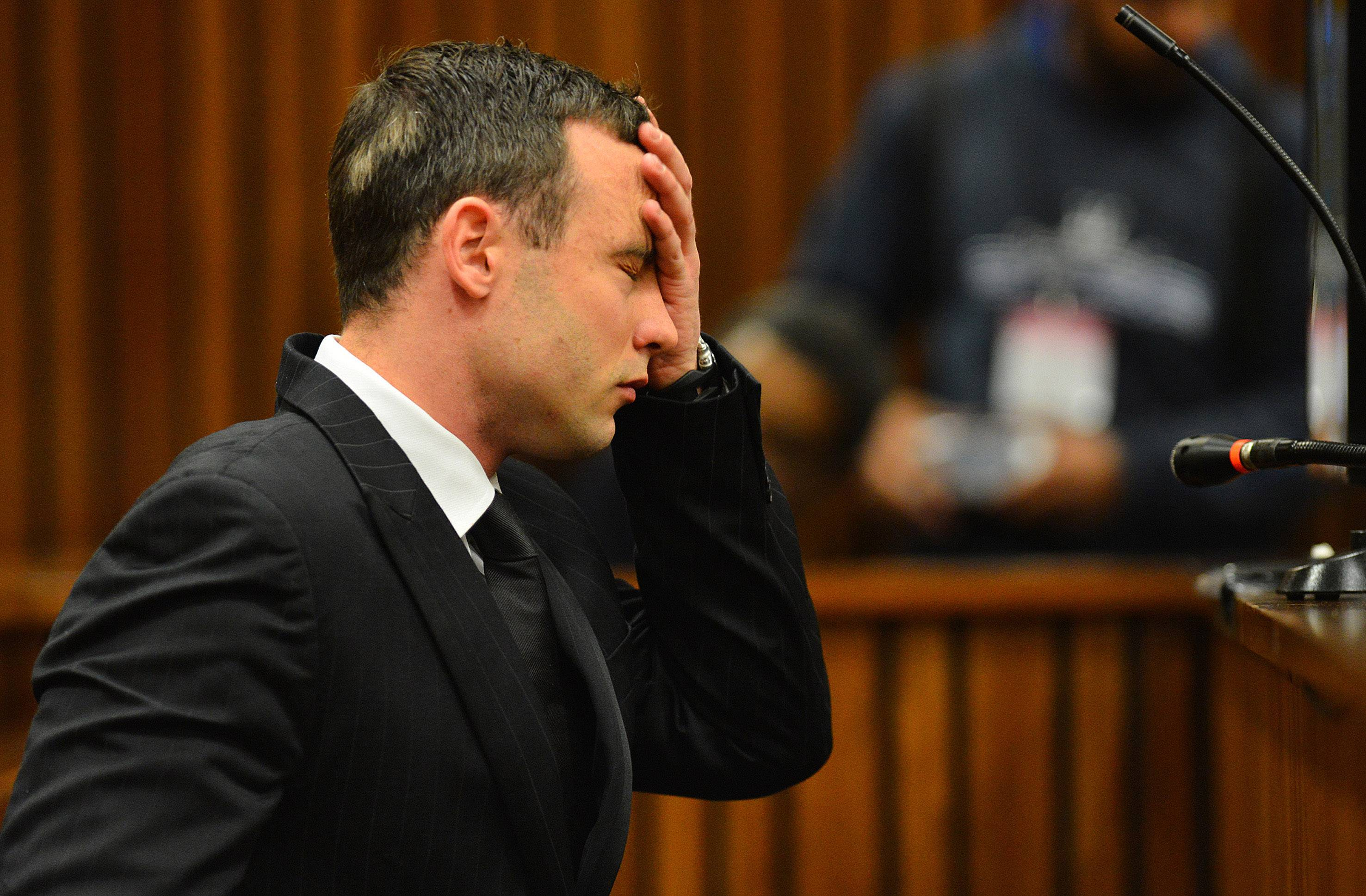 Oscar Pistorius listens to evidence in court in Pretoria, South Africa, Monday, when the murder trial of Pistorius resumed after one month during which mental health experts evaluated the athlete to determine if he has an anxiety disorder that could have influenced his actions on the night he killed girlfriend Reeva Steenkamp.