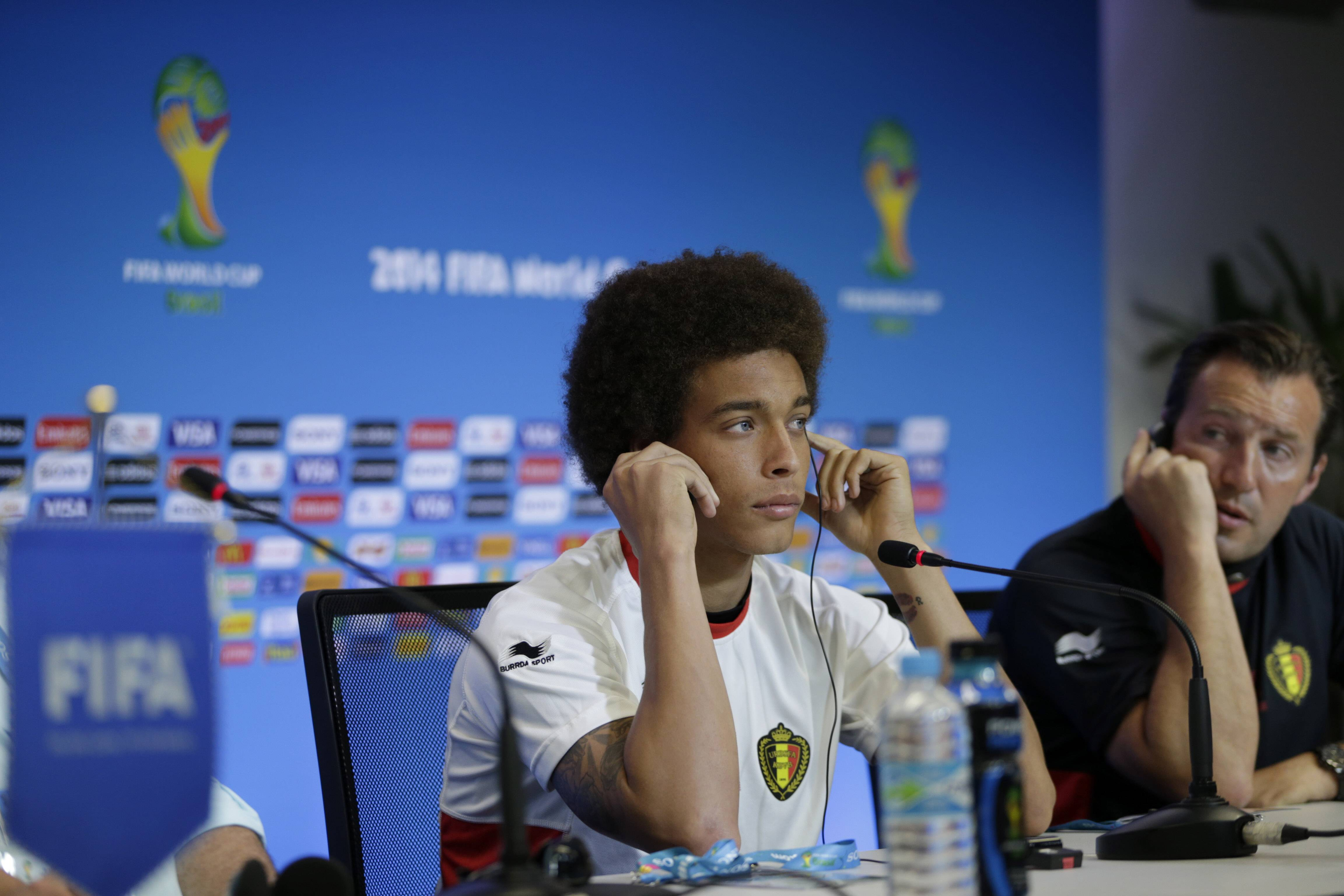 Belgium's Axel Witsel, left, and head coach Marc Wilmots Monday during a press conference the day before their World Cup round of 16 soccer match against the United States at Arena Fonte Nova in Salvador, Brazil.