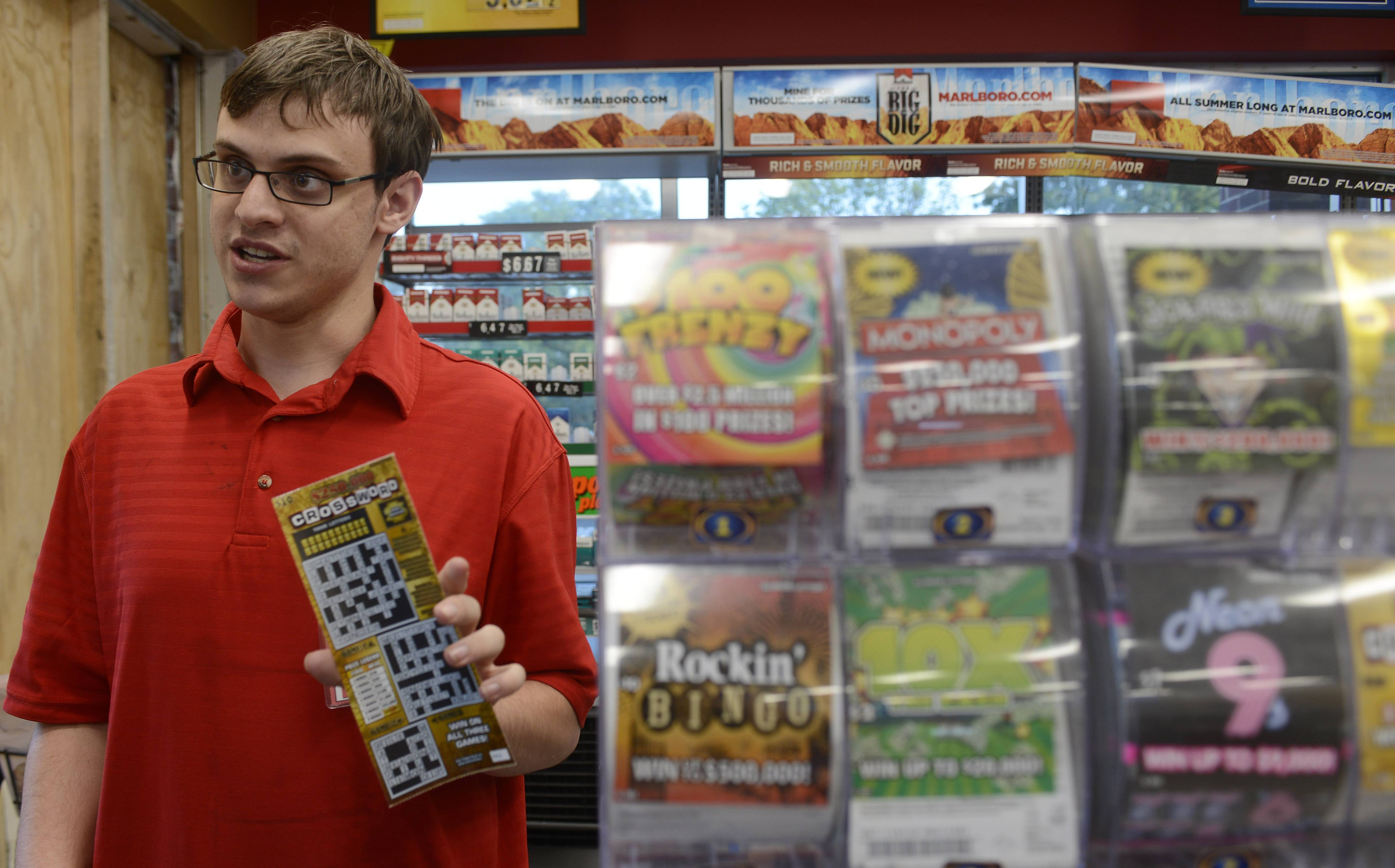 Clerk Aaron Adams talks about the lottery as he works behind the counter at the Circle K convenience store on Lake-Cook Road in Barrington.
