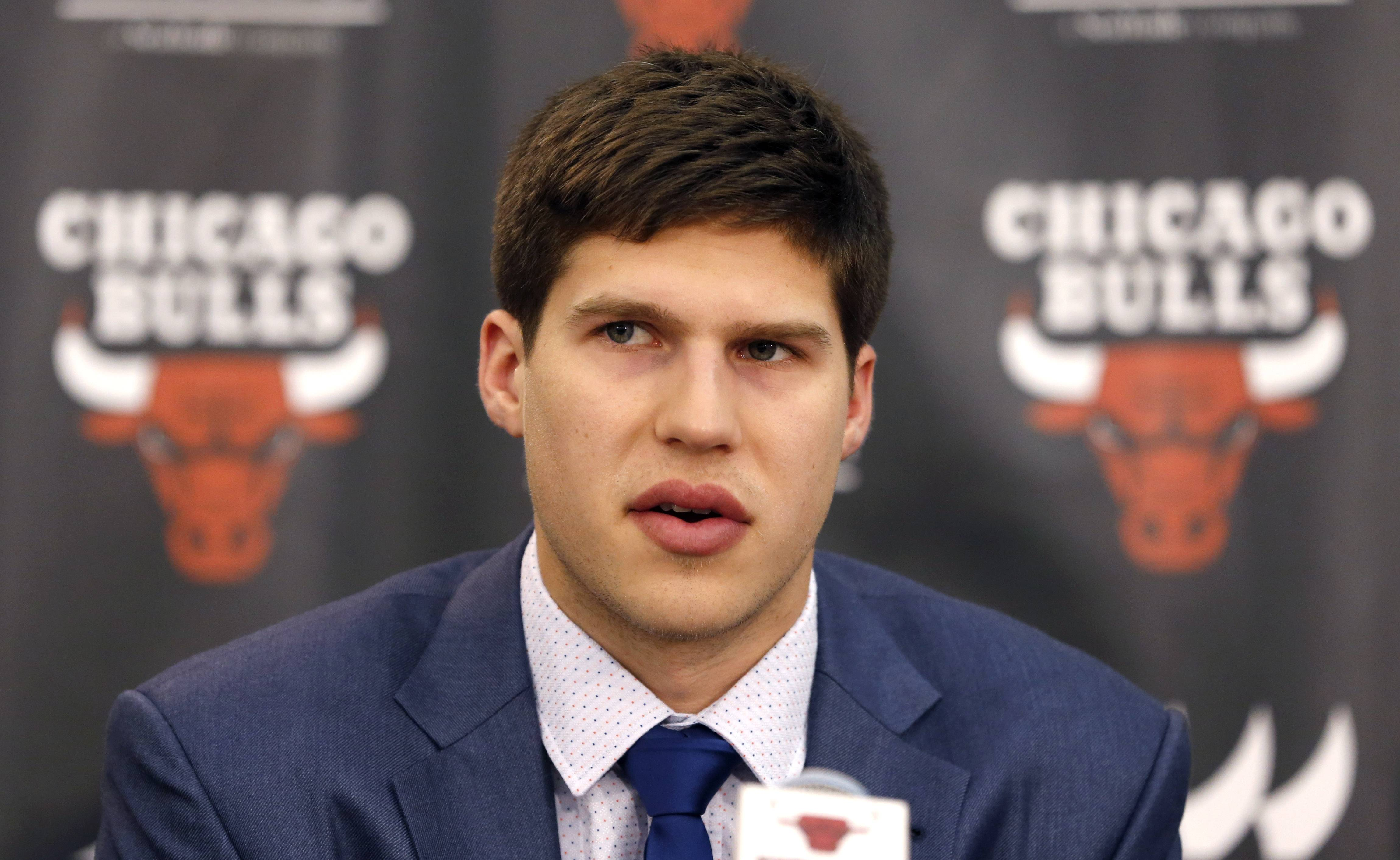 First-round draft pick Doug McDermott responds to a question during an introductory Bulls news conference Monday.