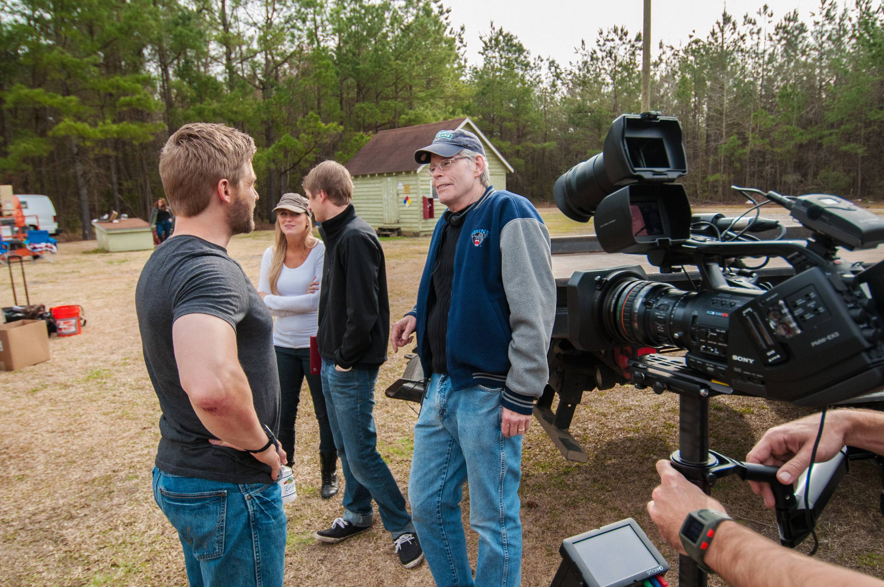 "Actor Mike Vogel, left, chats with executive producer Steven King on set for ""Under the Dome,"" in Wilmington, North Carolina."