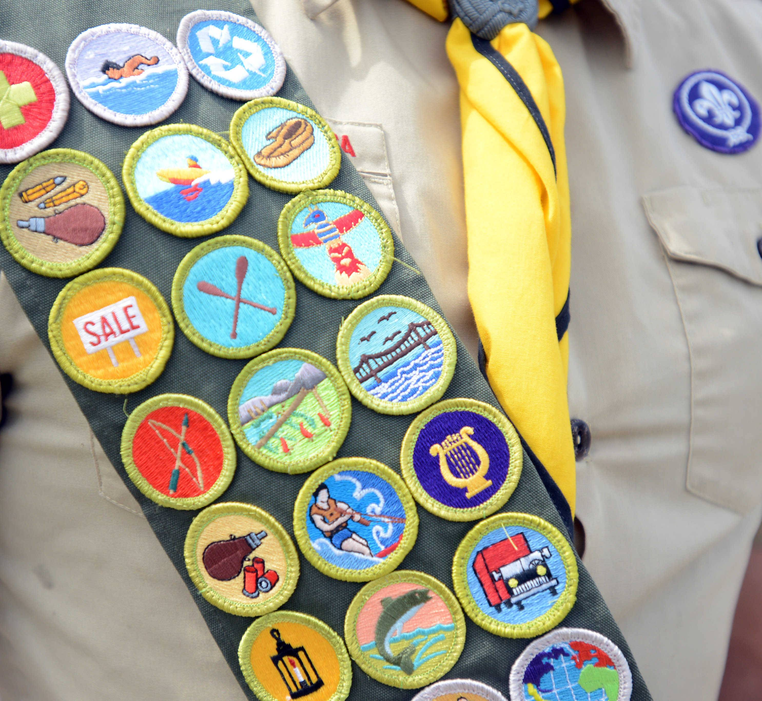 John Meyer, 17, of Des Plaines dons his merit badges Monday afternoon at the senior center in Des Plaines.
