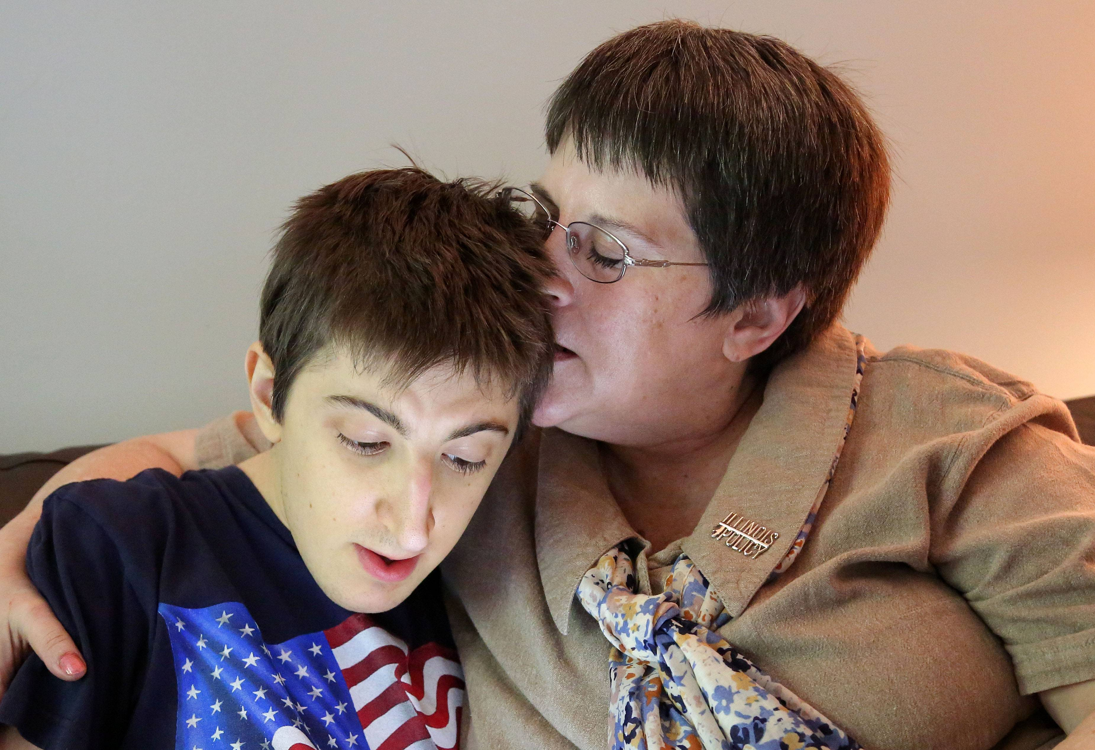 Pam Harris kisses 25-year-old son Josh at their Winthrop Harbor home after the U.S. Supreme Court ruled in her favor. Harris wanted to avoid having to pay mandatory dues to the union that represents similar Illinois workers, and she won her yearslong court case Monday.