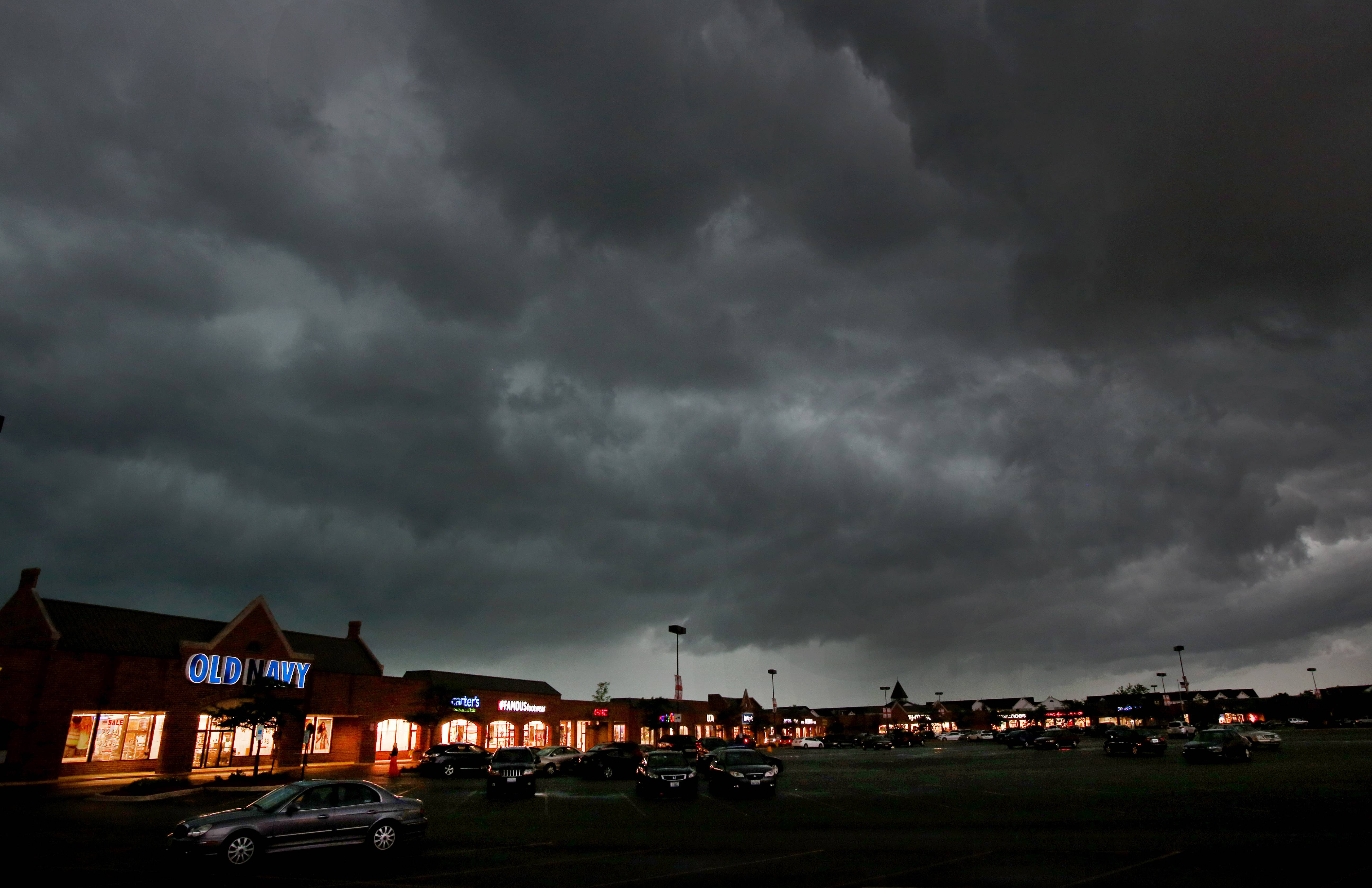 Ominous clouds move in over Danada Shopping Center on Butterfield Road in Wheaton as a storm passes through DuPage County on Monday.