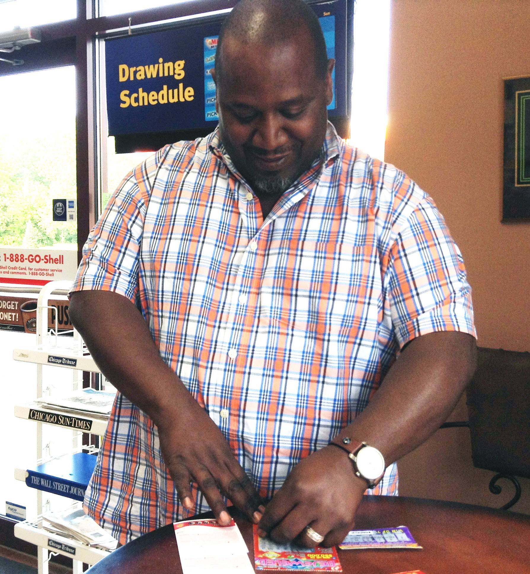Maurice Shoots of Mundelein buys lottery tickets at the Car Spa Shell in Libertyville.