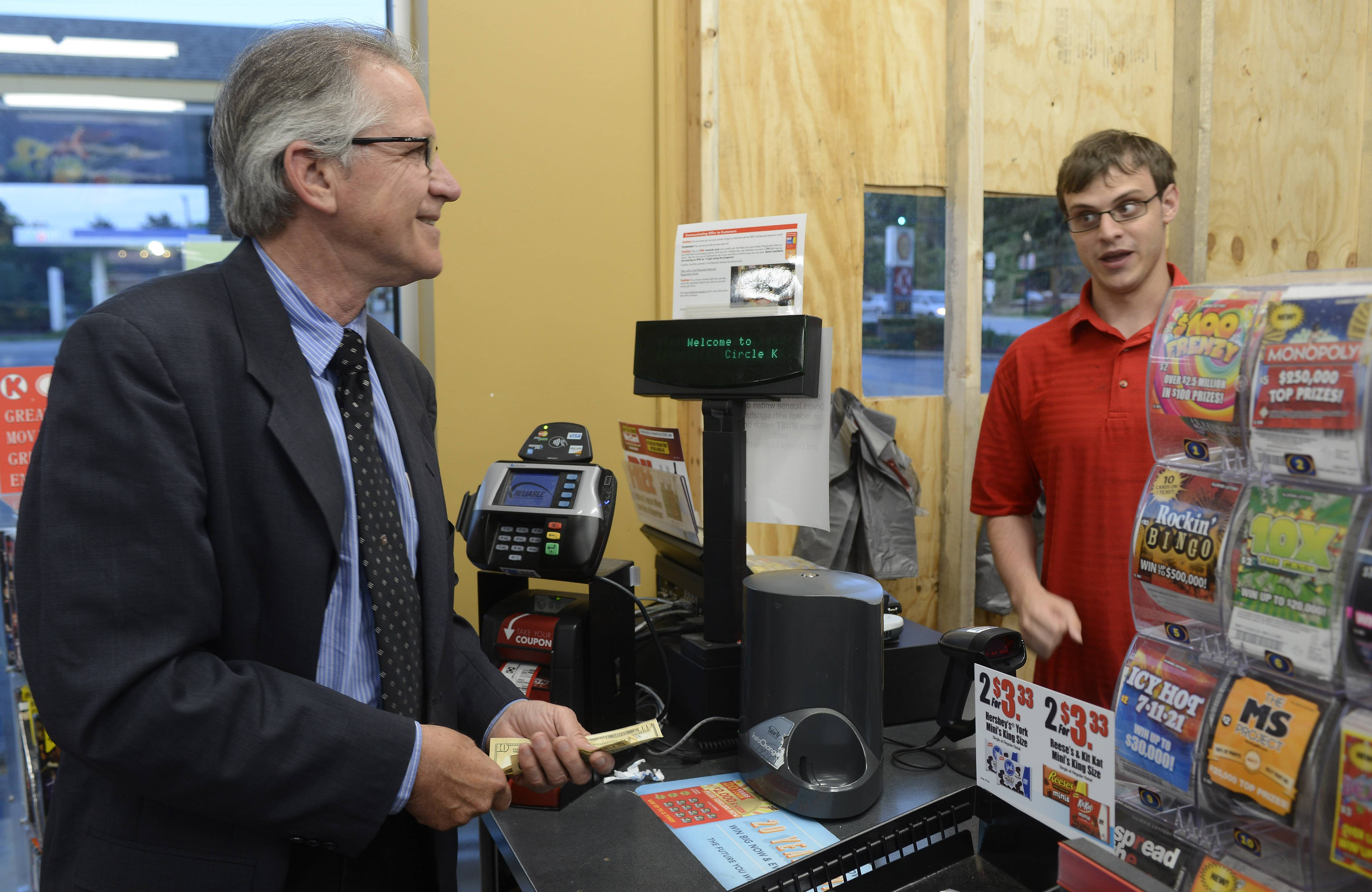 Ray Witczak of Barrington, left, talks to clerk Aaron Adams while playing the lottery at the Circle K convenience store on Lake-Cook Road in Barrington.