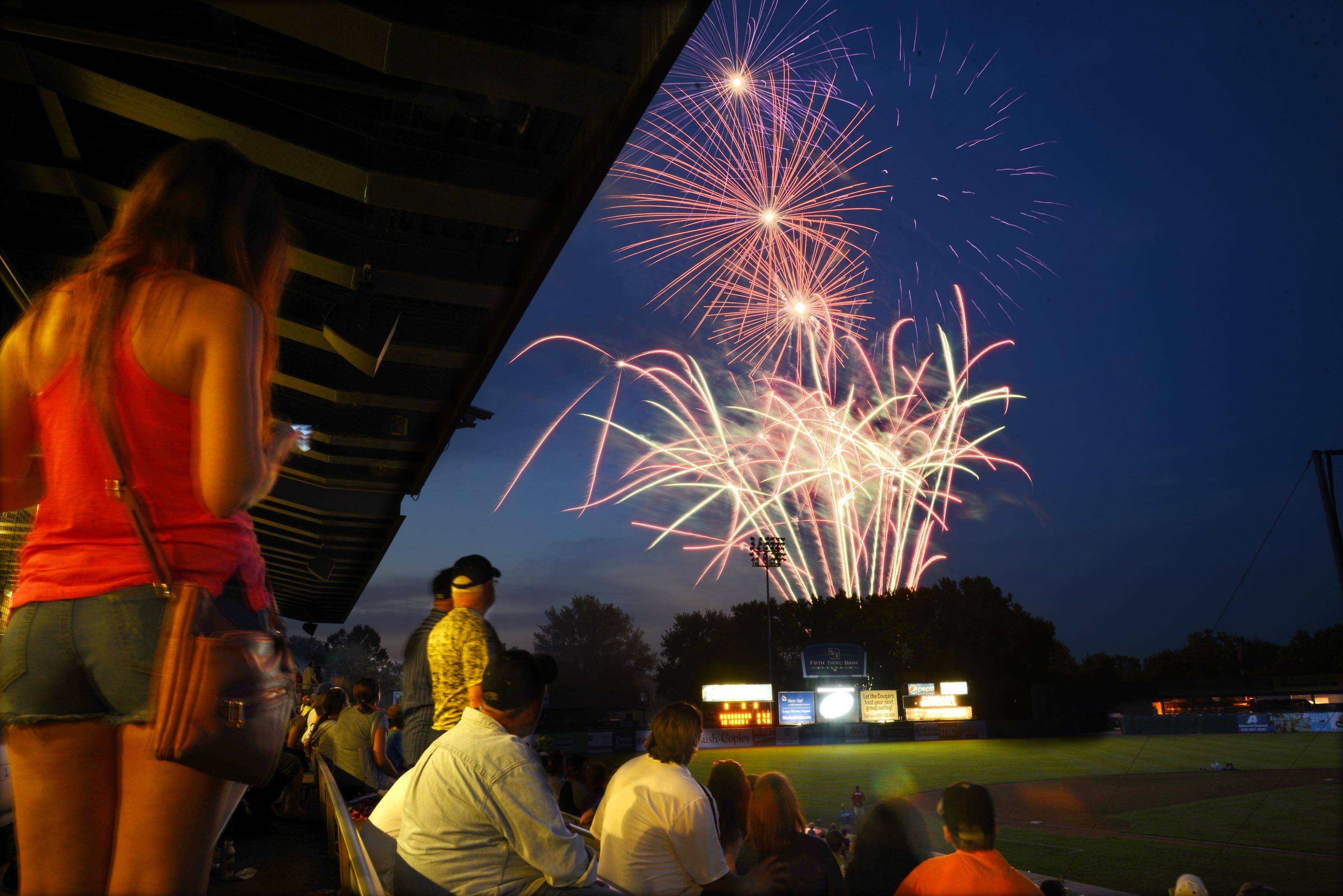 Fireworks light up the sky over Fifth Third Ballpark after the Kane County Cougars baseball game Wednesday night in Geneva.