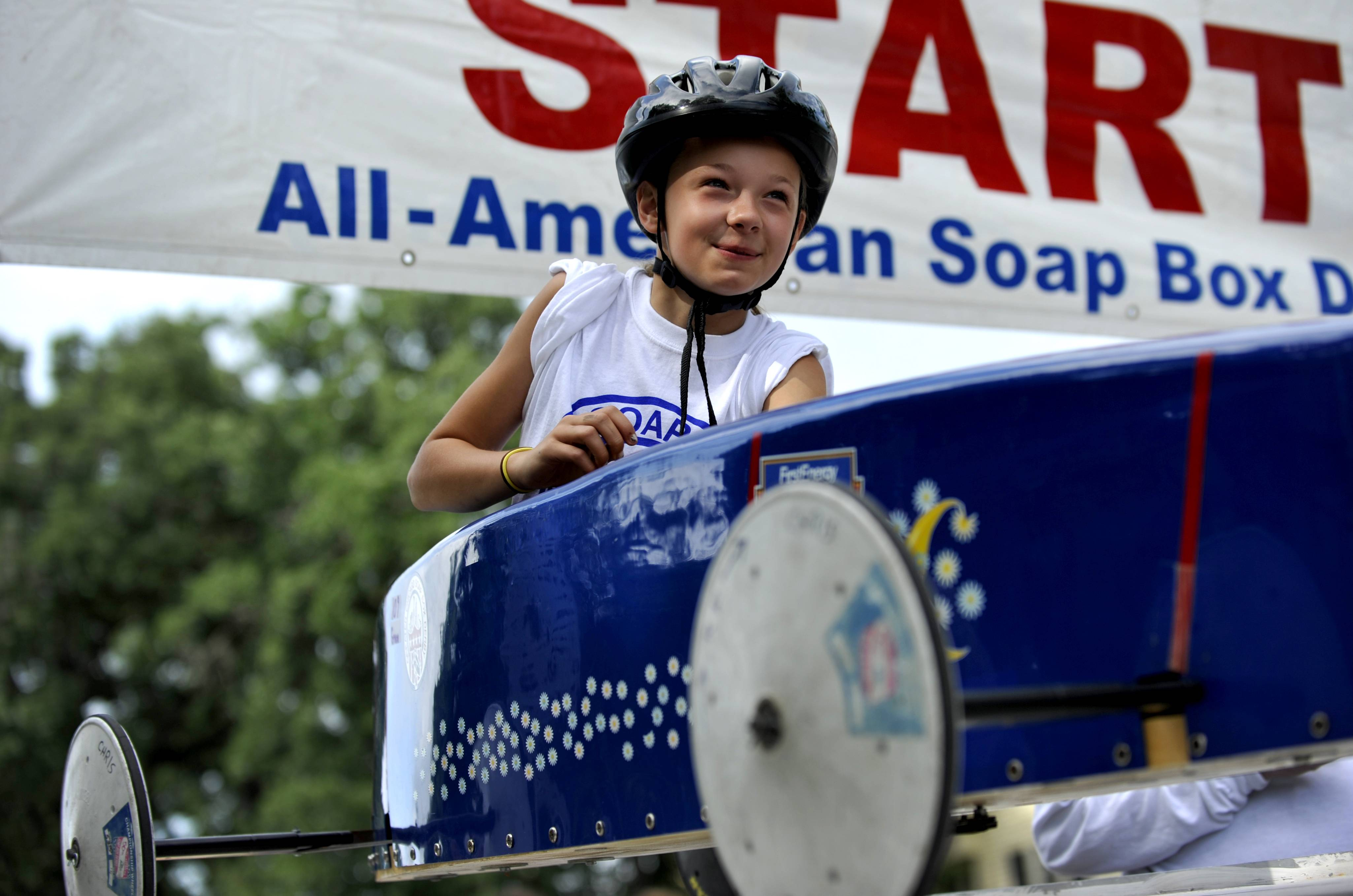 Grace Meshenky, 9, of South Elgin, gets ready for her very first race at the Geneva All American Soap Box Derby Race in downtown Geneva on Saturday. The winner from this round moves on to the world championships in Akron, Ohio.